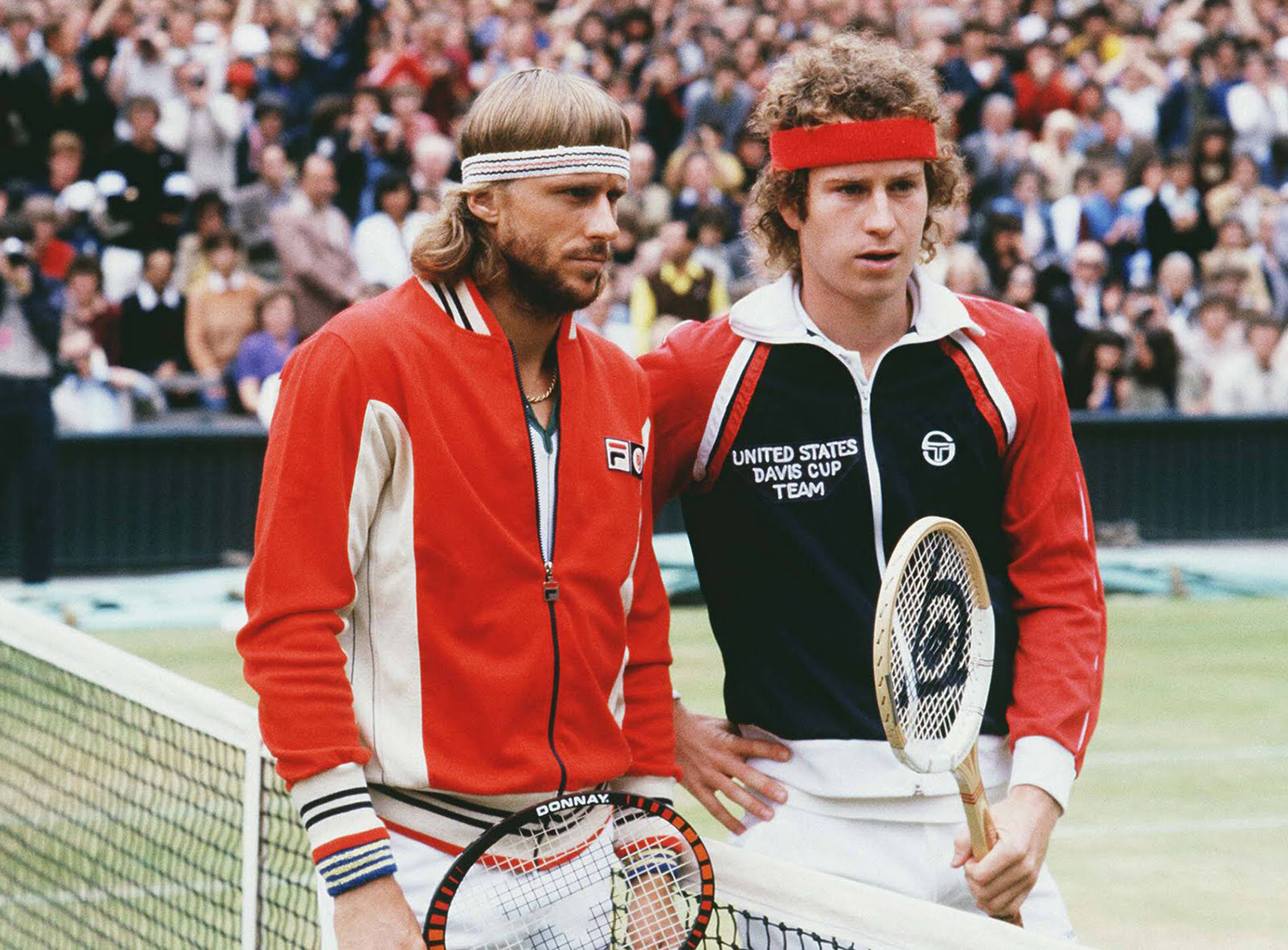 Rivals Bjorn Borg and John McEnroe making small talk before their match at Wimbledon in 1980. Well, more McEnroe talking and Borg just...not.