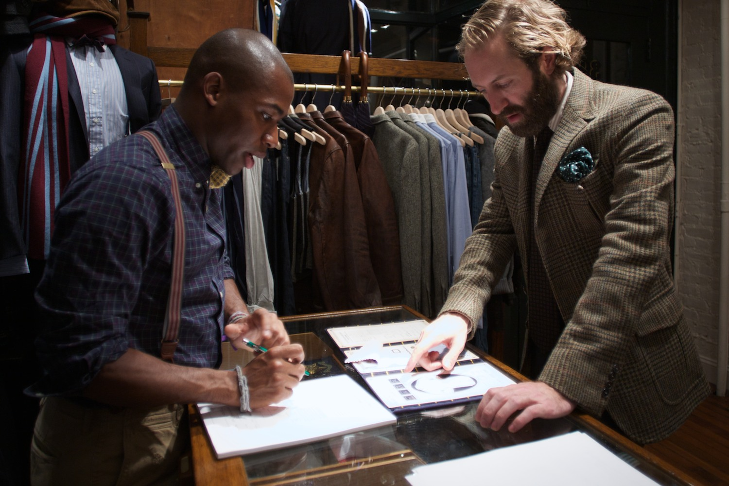 Linton helping David Coggins with a made-to-order shirt.