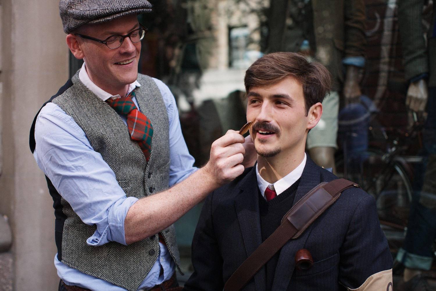 What—just one grown man combing another grown man's mustache.