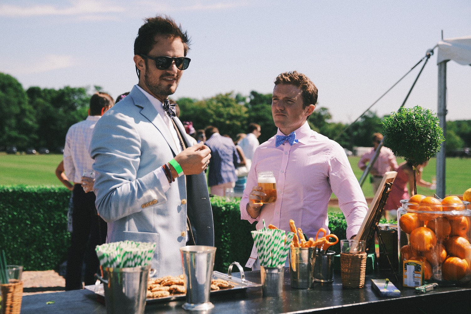 Swirl striped paper straws, wicker beer pitchers, and mason jars with your initials written in wax pencil were only a few of the details that made The Party Carpet Tailgate so fun.