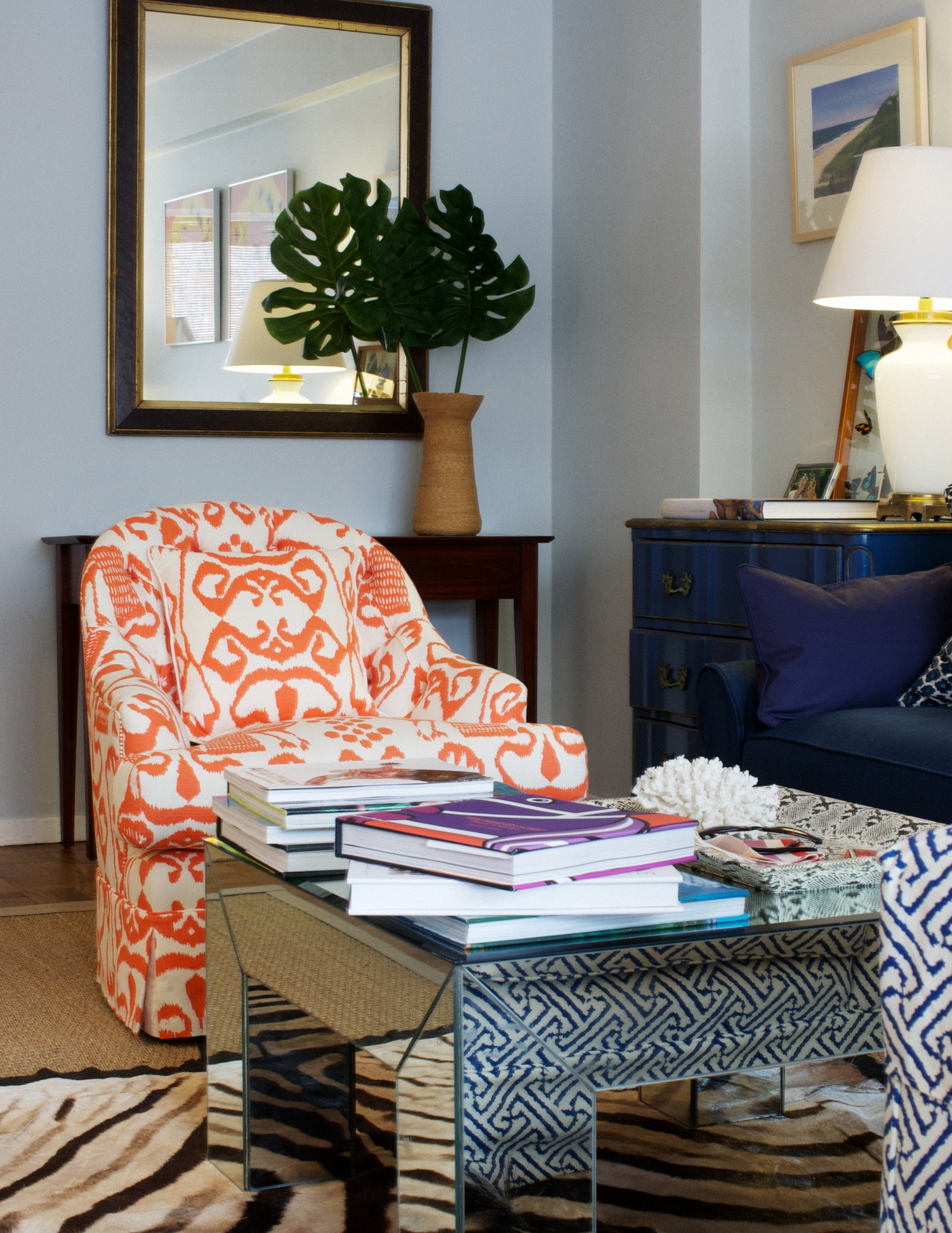 The printed upholstery is all Quadrille fabrics, as well as the wallpaper in the hallway.