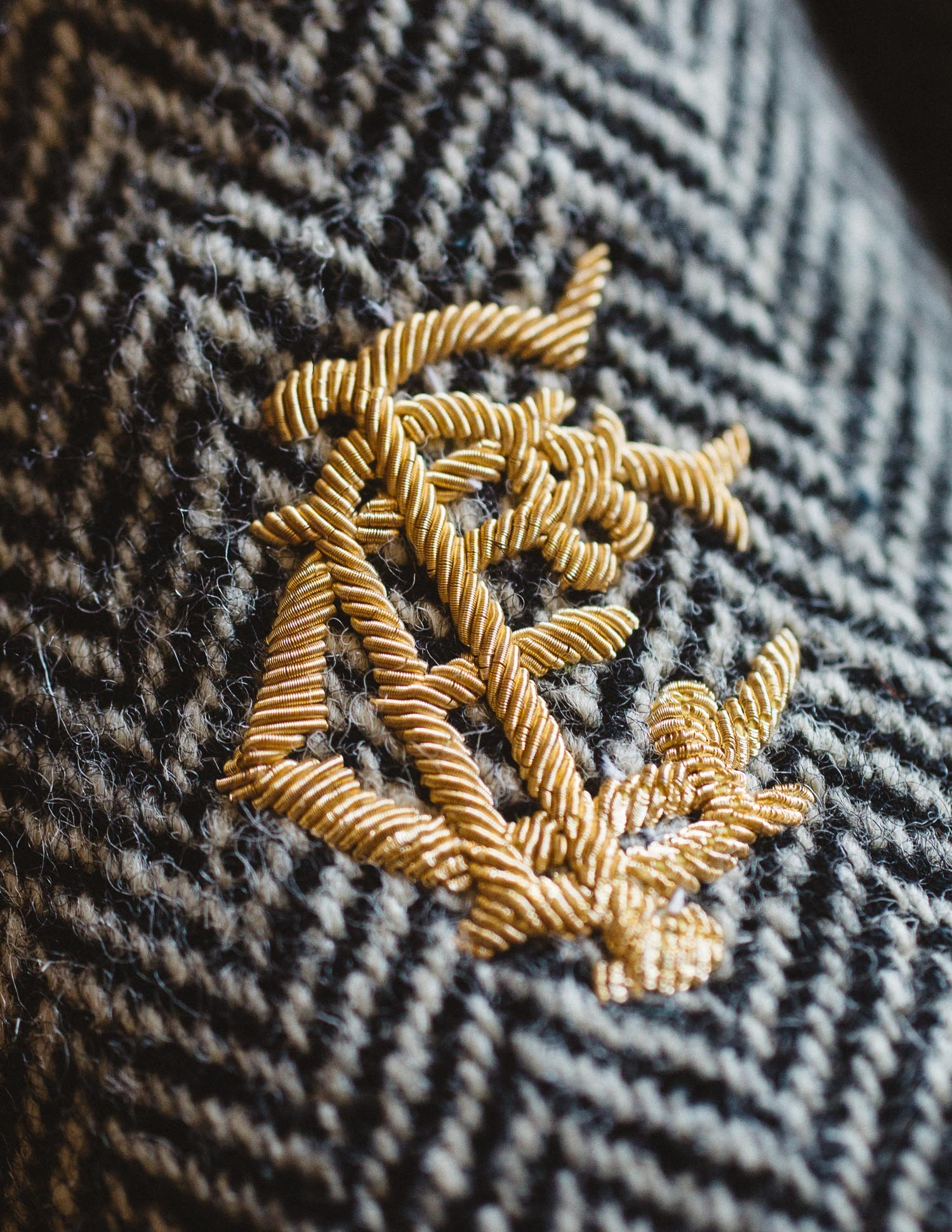Hand embroiderd 14K gold bullion monogram.