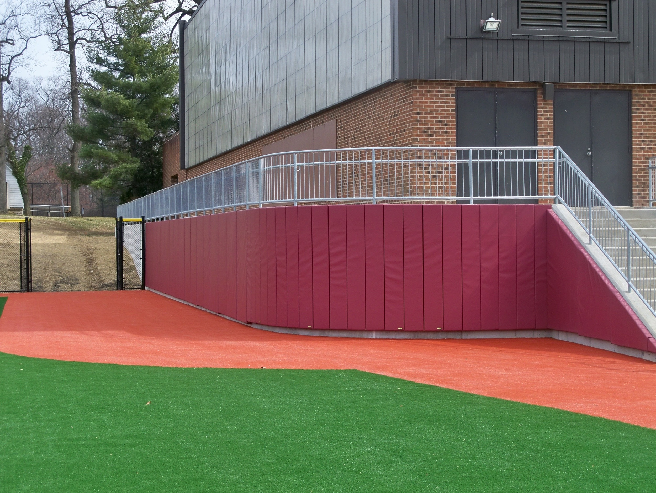SJU 005 03.09.12 Curved Wall Padding at BB Outfield.jpg