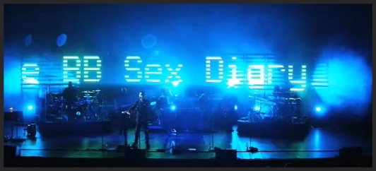 During live performances of Inertia Creeps, the LED screen broadcasts tadloid headlines from the same day as each show.