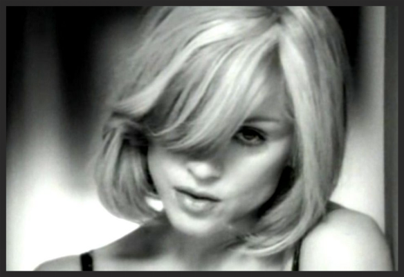 Video Still from the Earle Sebastian directed promo for I Want You featuring Madonna.