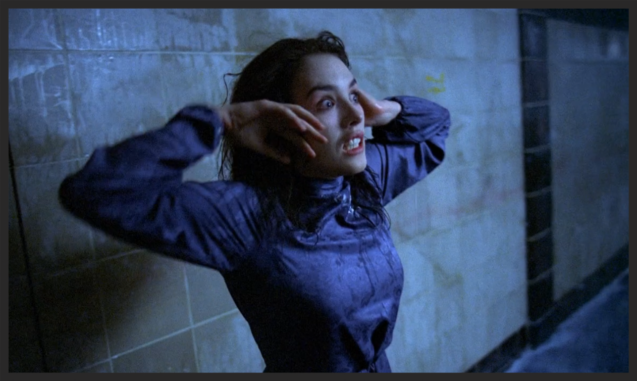 A still from the  1981 horror film Possession , which served as chief inspiration for the video for Voodoo In My Blood, wherein both a woman gets taken over by an invisible force in an abandoned underground station