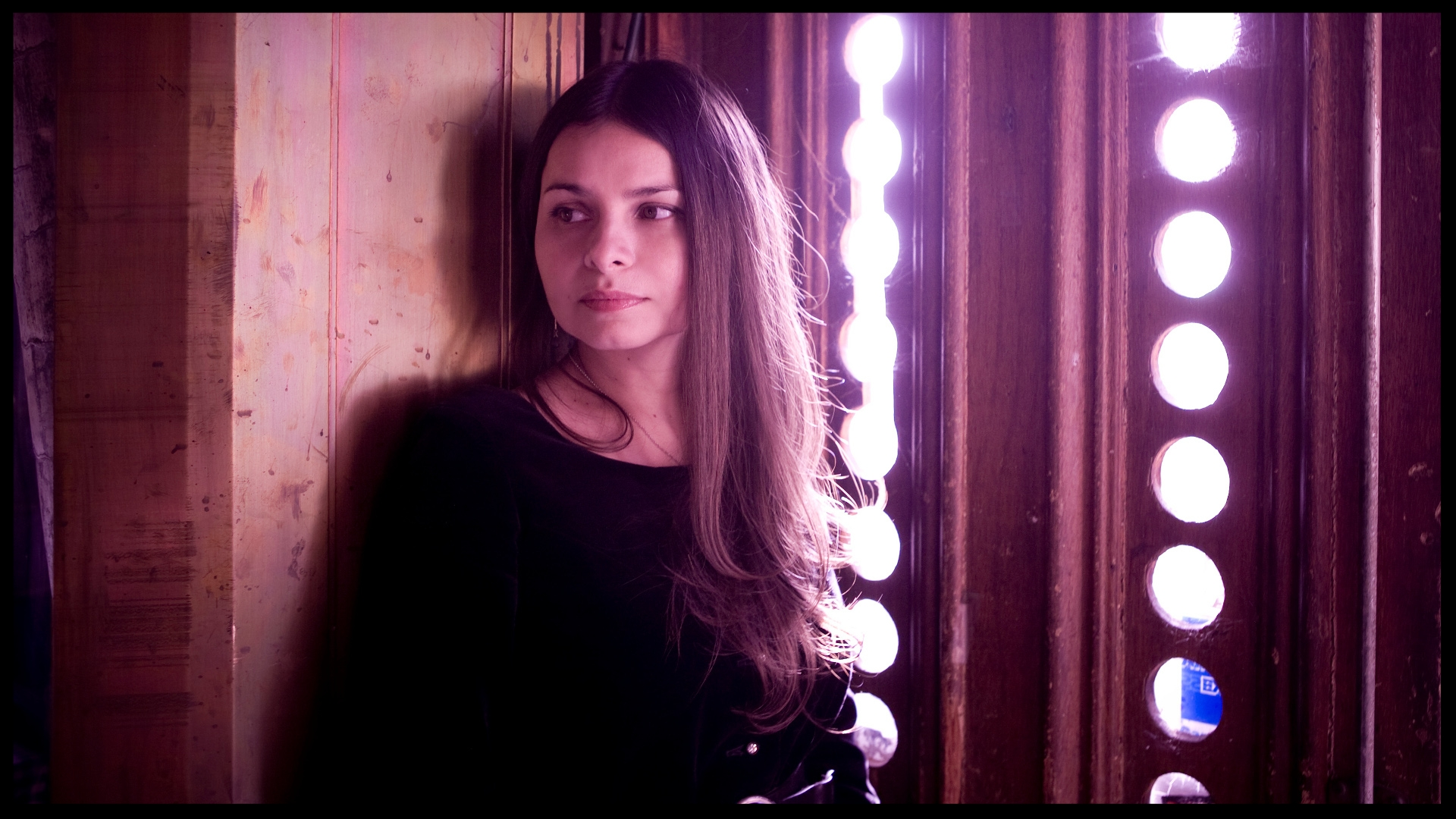 "Former Mazzy Star singer  Hope Sandoval  is the vocalist on ""The Spoils"". She previously worked with Massive Attack on  Paradise Circus ."