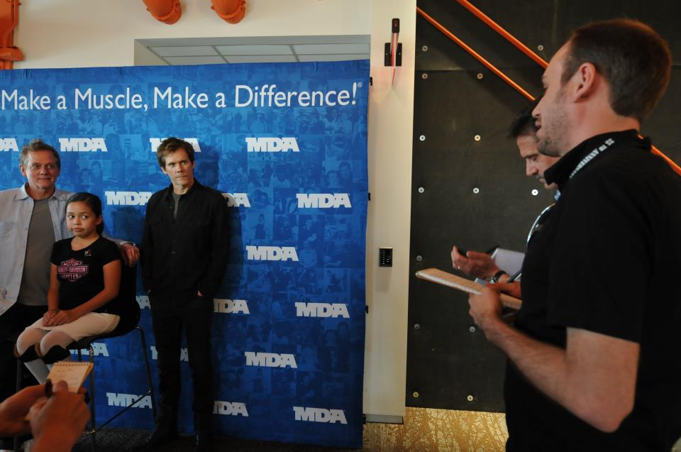 "Interviewing Michael Bacon, left, and his brother, actor Kevin Bacon, right, in May 2012 during the Muscular Dystrophy Association's ""Ride for Life"" fundraiser concert at the SteelStacks complex in Bethlehem.  Christopher Post Photo"