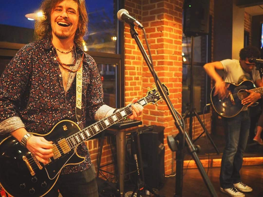 Guitarist-vocalist Shane Reimer, left, will celebrate the release of his debut solo LP,  Better Late Than Never , with concert at Pearly Baker's Alehouse in Easton.  (Photo Courtesy of Shane Reimer.)