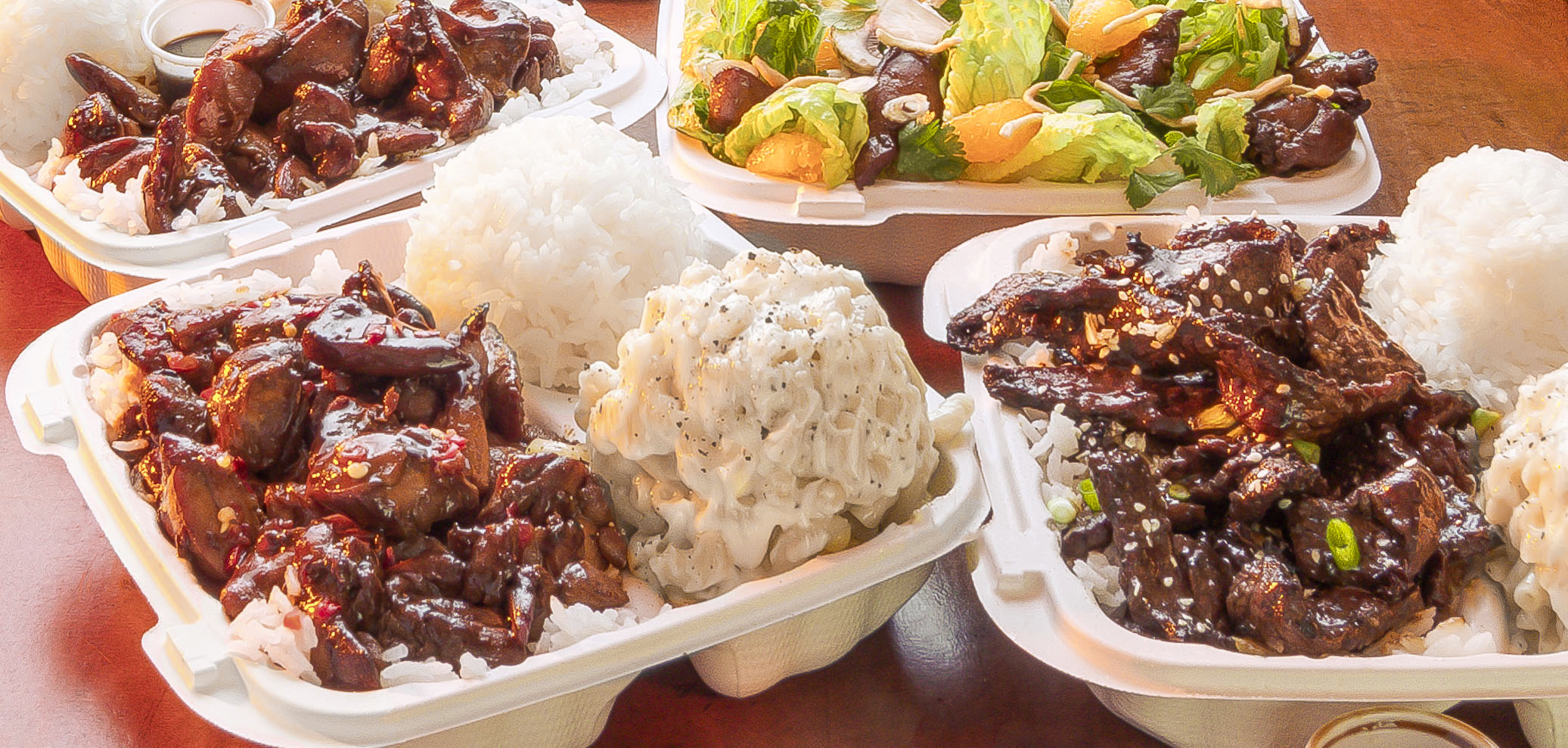 Clockwise from top: Huli Huli Chicken, Chinese Chicken Salad, Honolulu Beef, Mauna Loa Chicken
