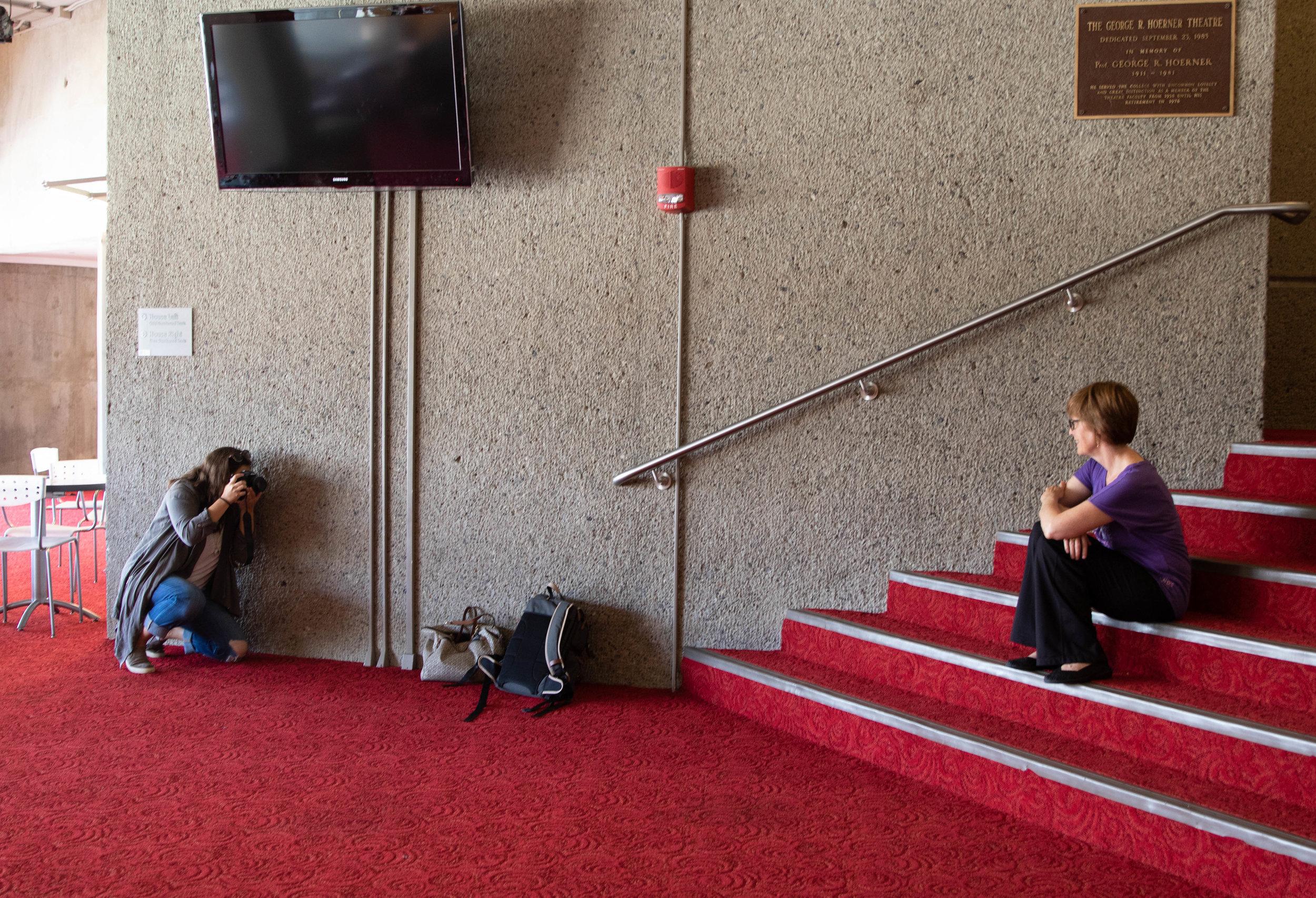 Kristen Harrison photographs theater professor Kathleen Mulligan for  The Ithacan. (Zach Cercone / Stillwater Magazine)