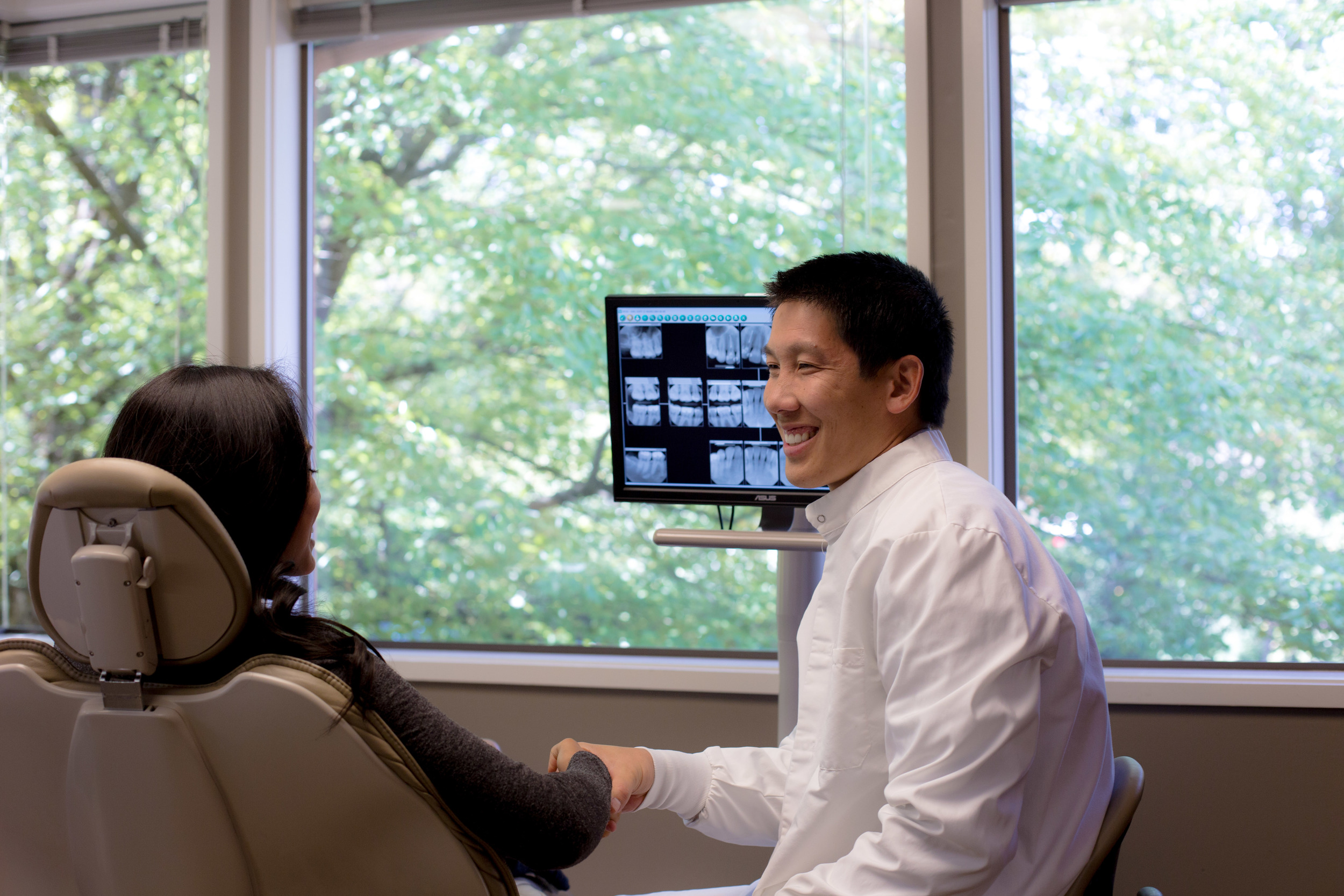 Dr Ryan Chiang meeting a patient at Bellevue Dental Arts