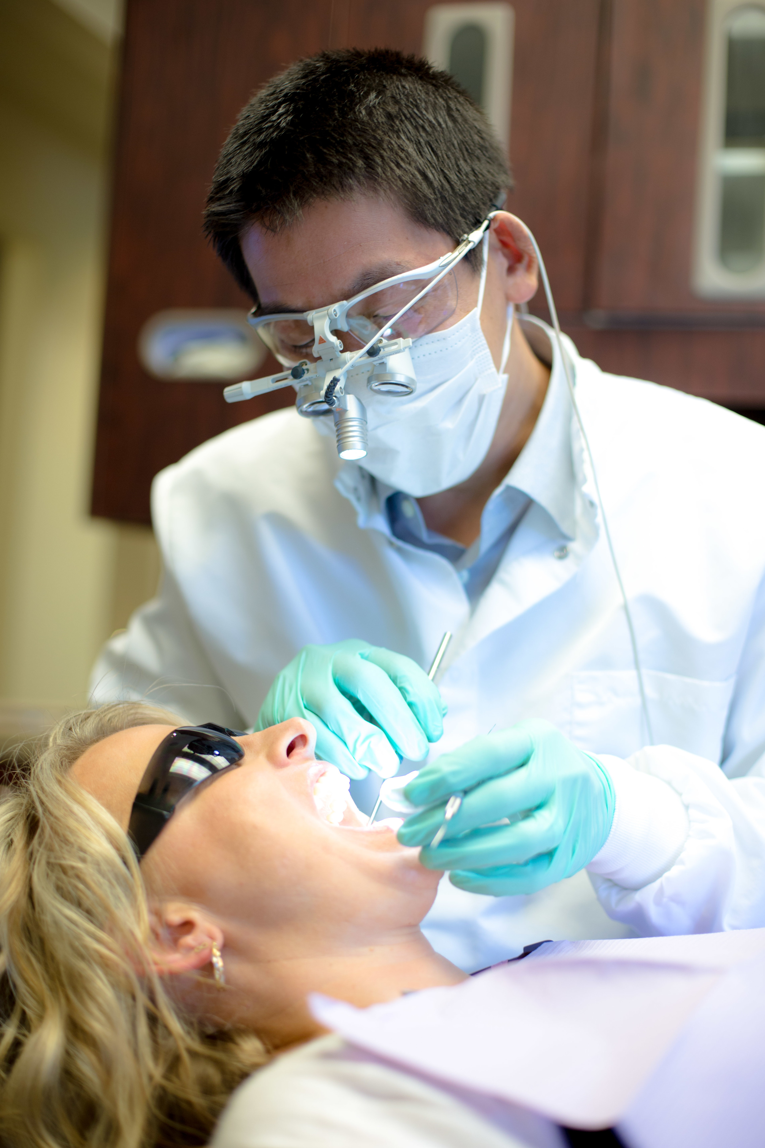 Dr Ryan Chiang working treating a patient at Bellevue Dental Arts