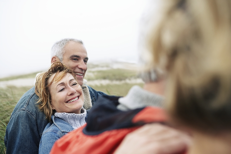 Bellevue Dental Arts cosmetic dentistry smiling elderly couple at the beach