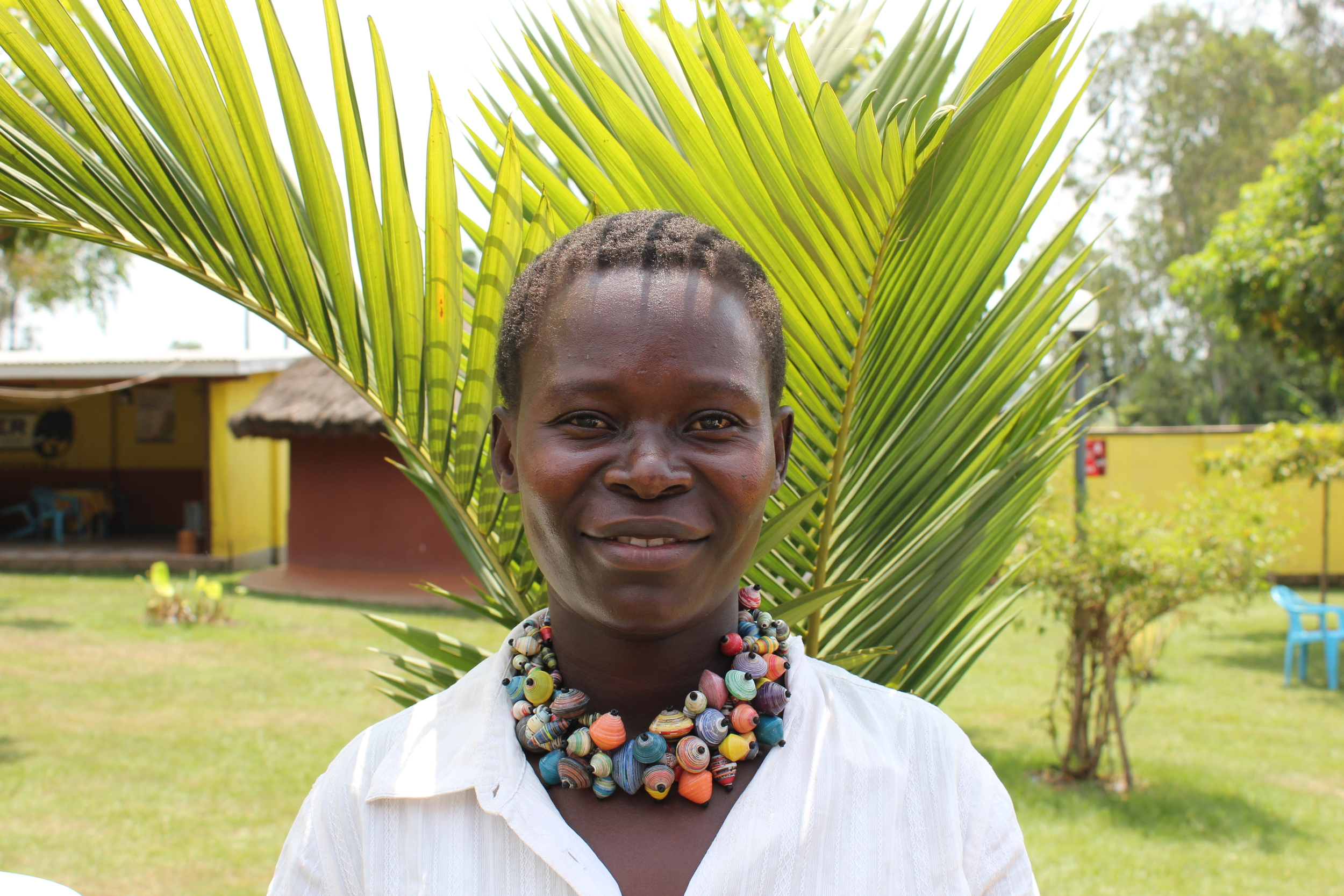 Laker Margret is 32 years old, caring for 7 children. 4 of which are her own, and 3 are under her care. Margret spends her days farming and making paper beads. Beading has allowed Margret to feed her children and buy the necessary scholastic requirements to send them to school. She hopes to one day be self employed through selling crops in the market. She wishes for her children to continue studying well to achieve a better future.    Children:  Wokorach Innocent (16 years old), Lagen Winnie (13 years old ), Oyella Claudia (8 years old), Achayo Beyonce (2 years old), Atim Rema Sharon (16 years old), Kolo Jimmy (13 years old), Banya Charles (11 years old)
