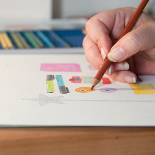 Liz Drawing with Pencils.jpg