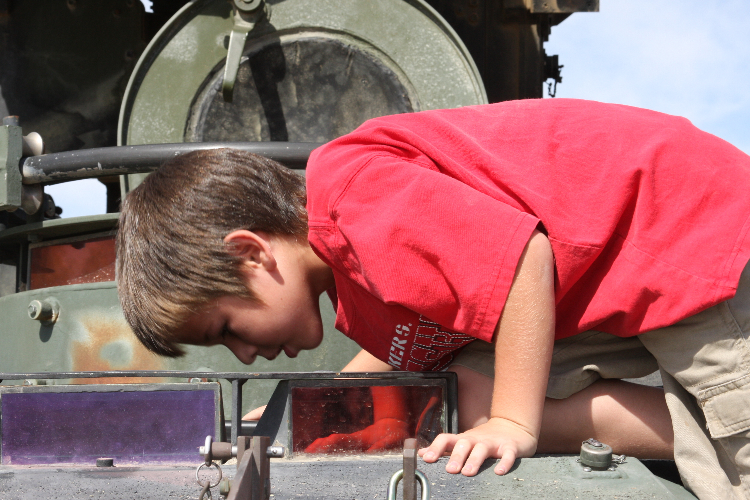 Zack Nelson, a second-grader at Palm Vista Elementary School in Twentynine Palms, Calif., peers down the assistant driver's hatch during the Wearable Power Prize competition technology showcase and kid's day at Del Valle Field.