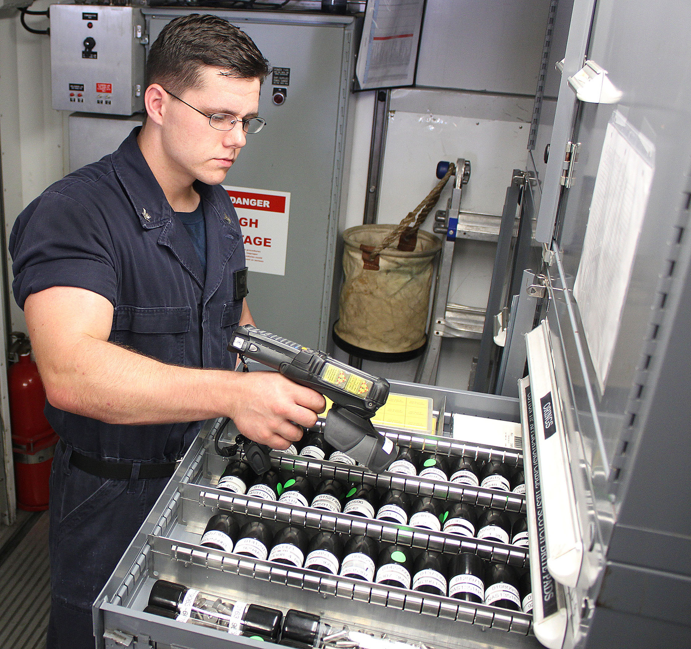 Pensacola, Florida - PENSACOLA, Florida - Machinist Mate Third Class Petty Officer (SW) Logan Peters uses a hand-held RFID scanner to conduct inventory aboard USS Independence. RFID technology provides the ability to dramatically reduce the time sailors spend conducting parts and equipment inventory in support of ship replenishment.   (Photo : Katherine Mapp, U.S. Navy/Released)