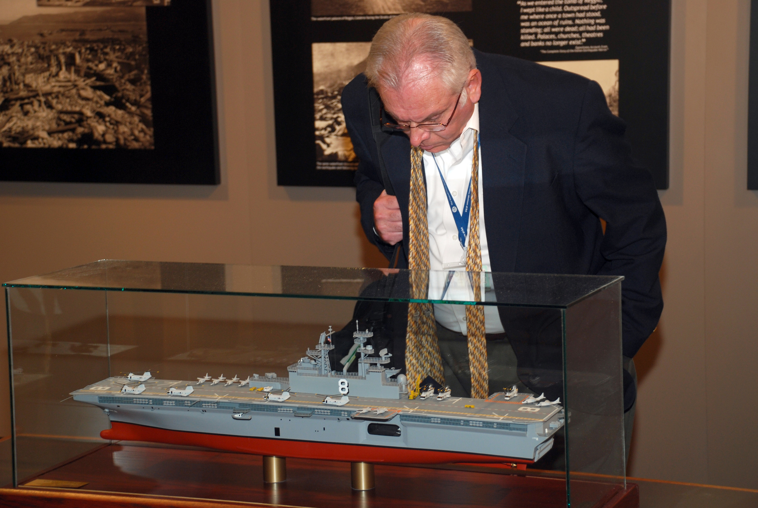 """A visitor to Grand Central Terminal in New York browses the """"Great White Fleet,"""" an exhibit presented by the Columbus Citizens Foundation in collaboration with the Office of the Secretary of the Navy."""
