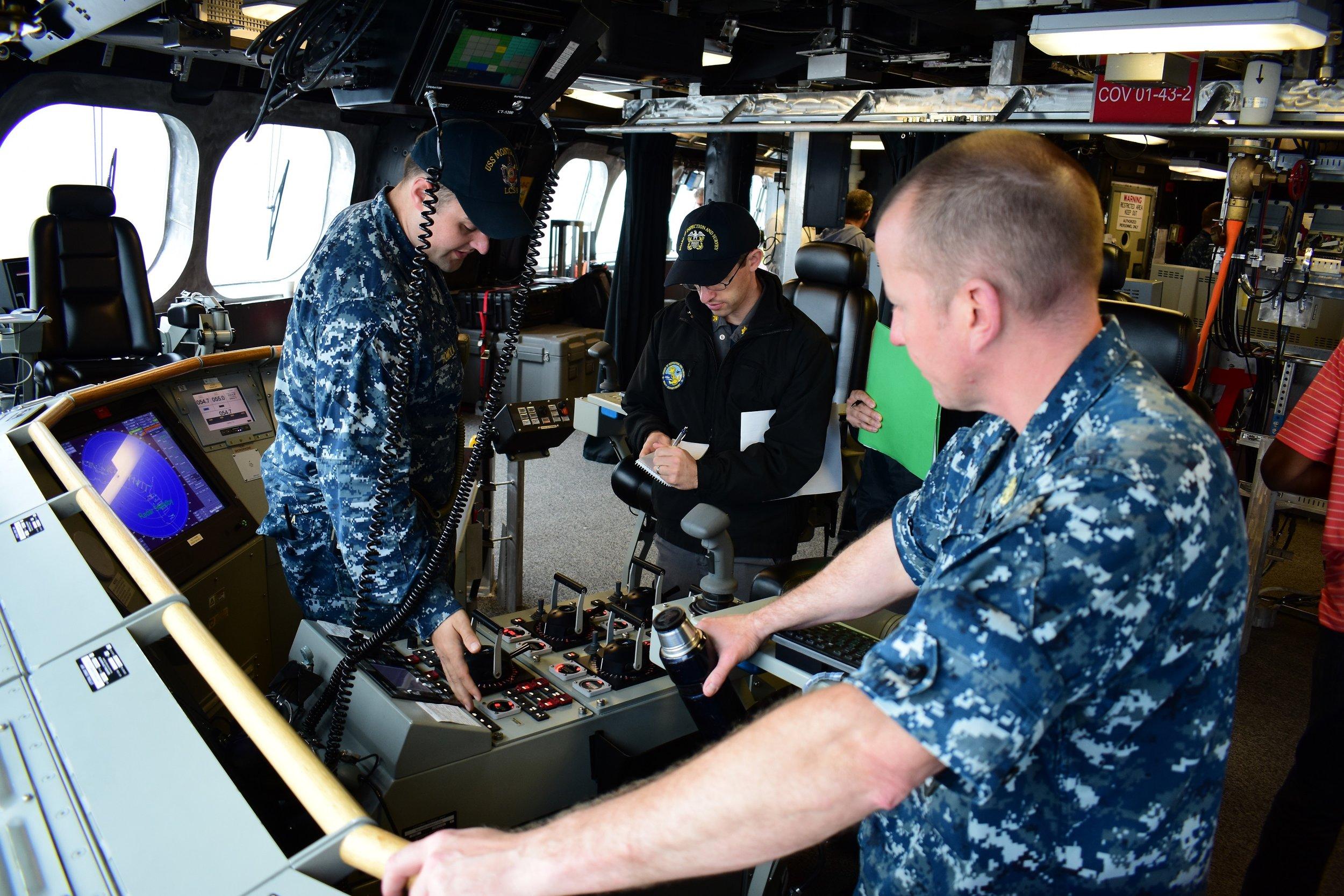 Naval engineering specialists aboard ship (U.S. Navy photo.)