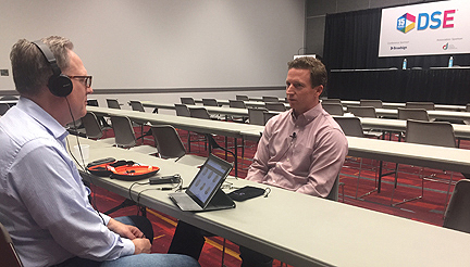 Vox Optima's Gary Potterfield talks digital signage strategies with Mason Page from Reflect Systems at the 2018 Digital Signage Expo in Las Vegas.