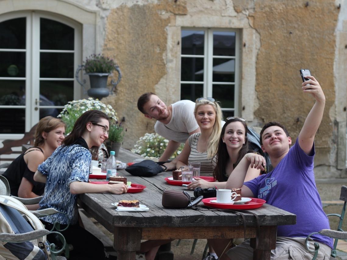 OVAA 2015 students having Kaffee und Kuchen nearSchloss Moritzburg
