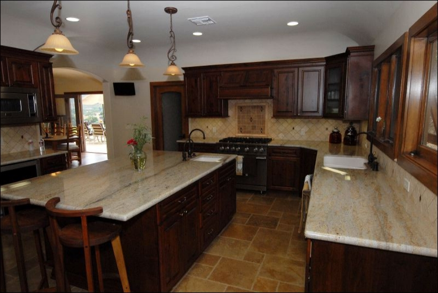 Stained cabinets throughout/granite counters and stone backsplash