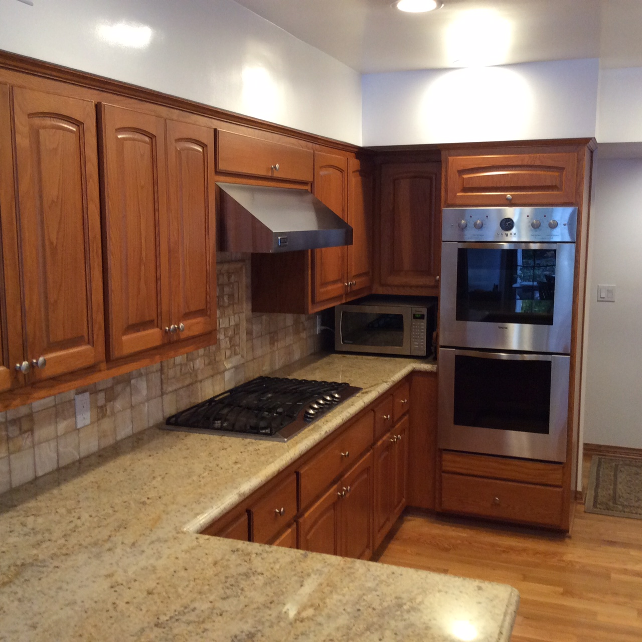 Refaced stain cabinets and granite counters