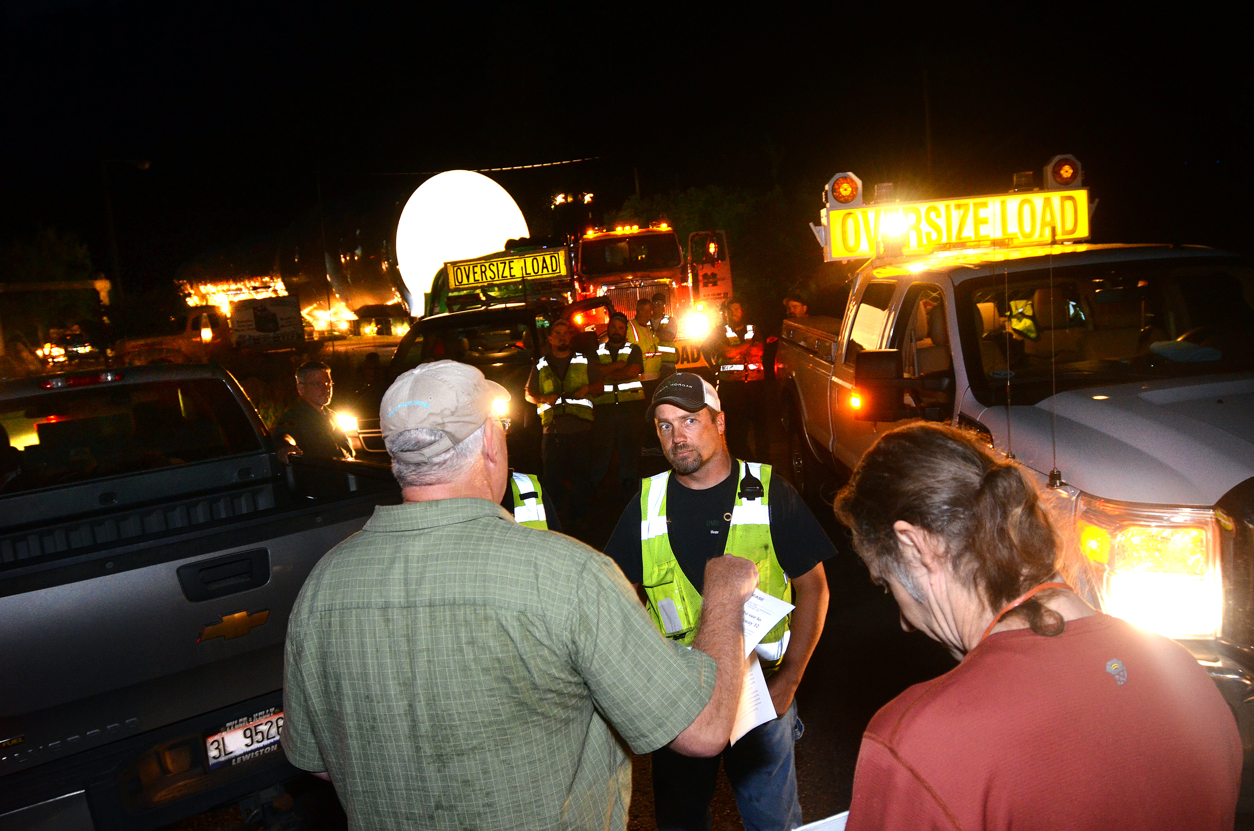 IRU Executive Director Bill Sedivy talks with the driver of a controversial Highway 12 megaload in August 2013. Photo (c) The Lewiston Morning Tribune.
