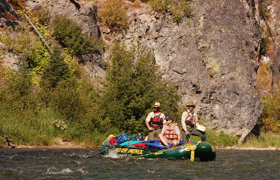 U.S. Forest Service biologists, with Middle Fork District Ranger Chris Grove at the bow, float the Middle Fork of the Salmon River looking for chinook salmon. Photo by Kevin Colburn.