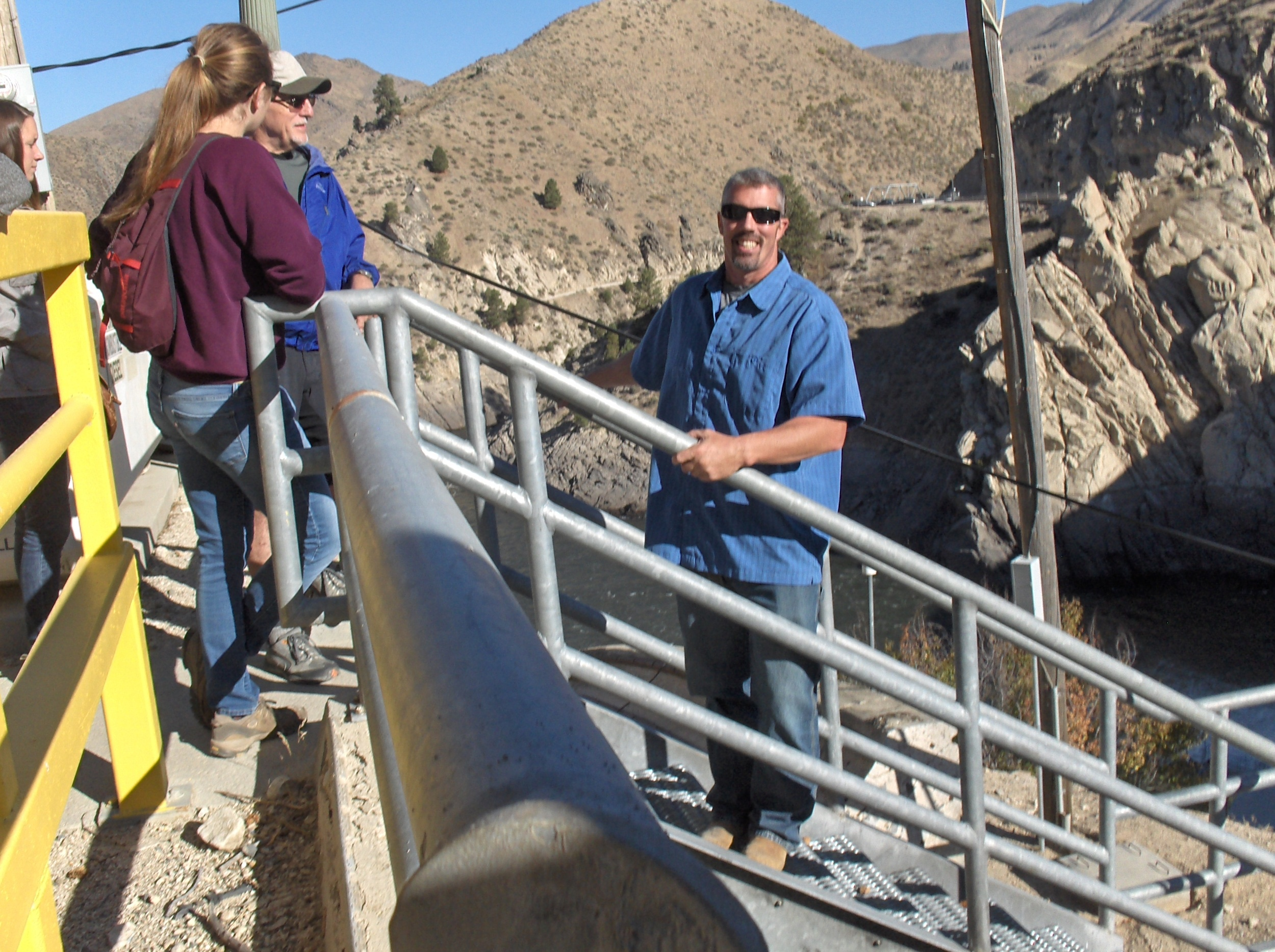 Arrowrock Dam Maintenance Supervisor Michael Anselme, pictured in blue, leads a tour of the dam for 25 IRU members.