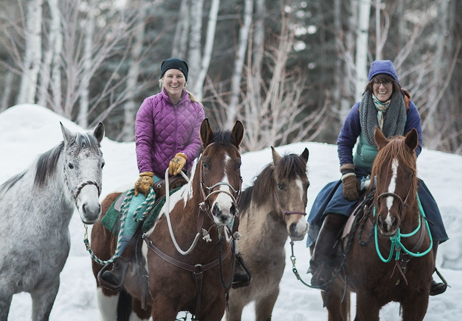 Katelyn Spradley, left, and Kat Cannell are two members of a three-woman team that's riding horses this spring from Astoria, Ore., to Stanley, Idaho to bring more awareness to the plight of wild salmon. Photo courtesy Kat Cannell