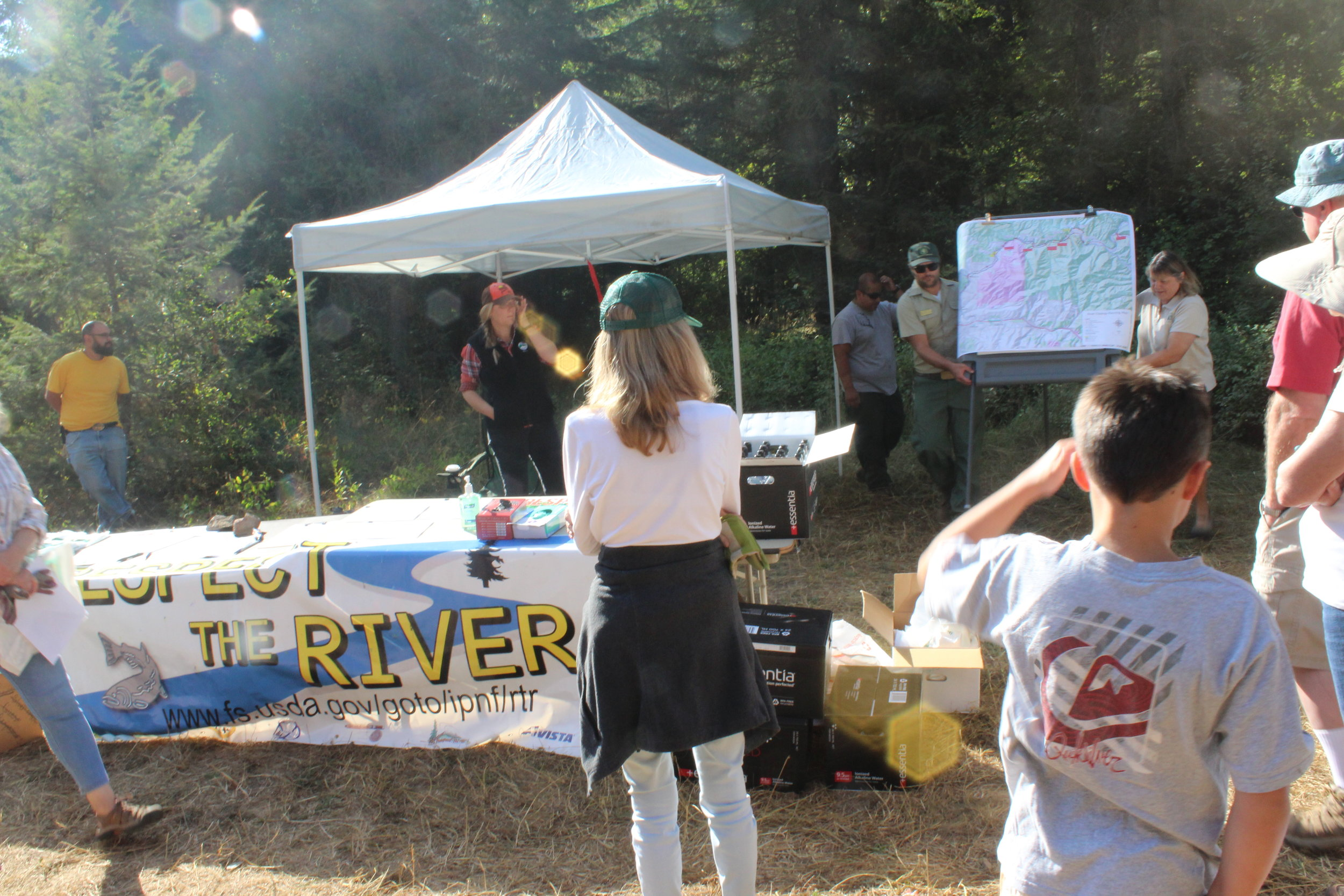 The Respect the River cleanup crew gathers to begin hauling trash away from the North Fork.