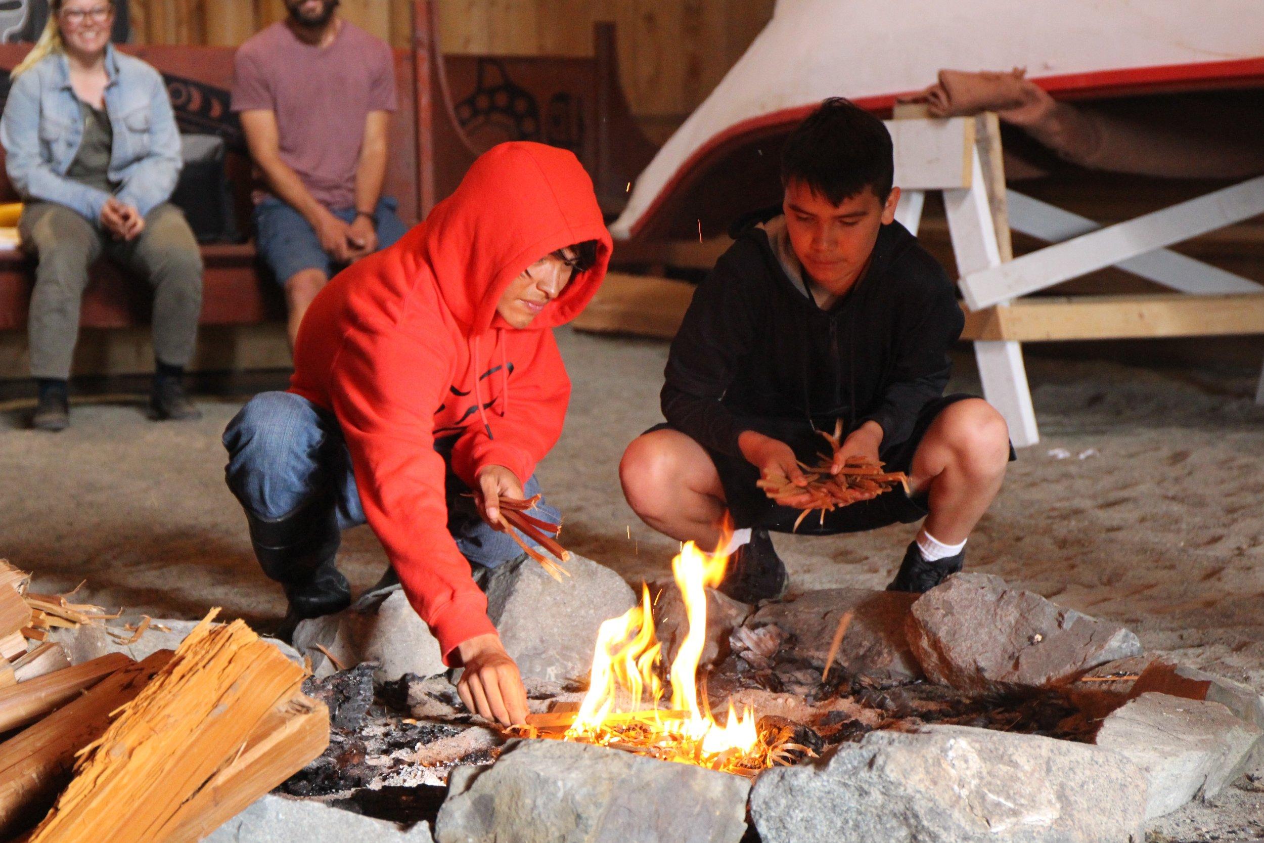 Graduation ceremony participants making fire_4_JS.jpg