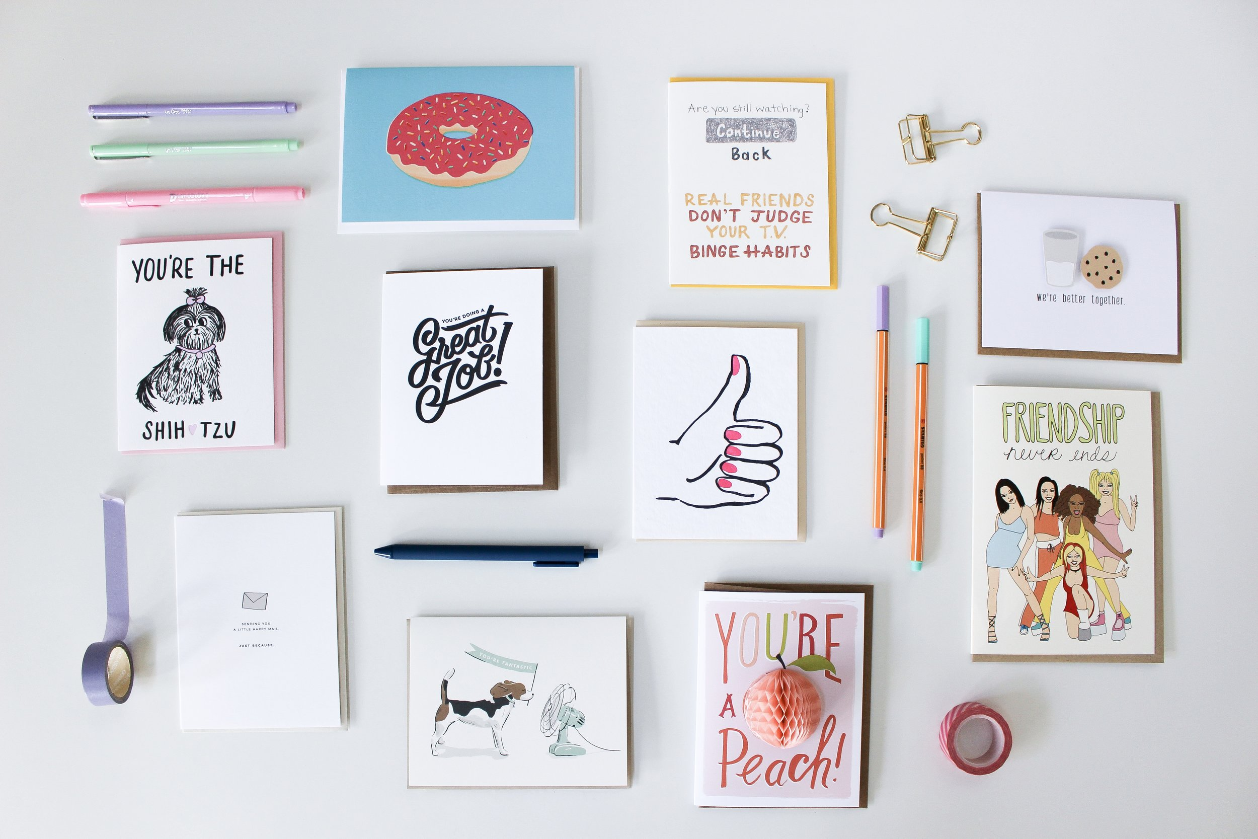 The Paper + Craft Pantry Blog: Overview of all the cards and a few pens laying flat on the table.