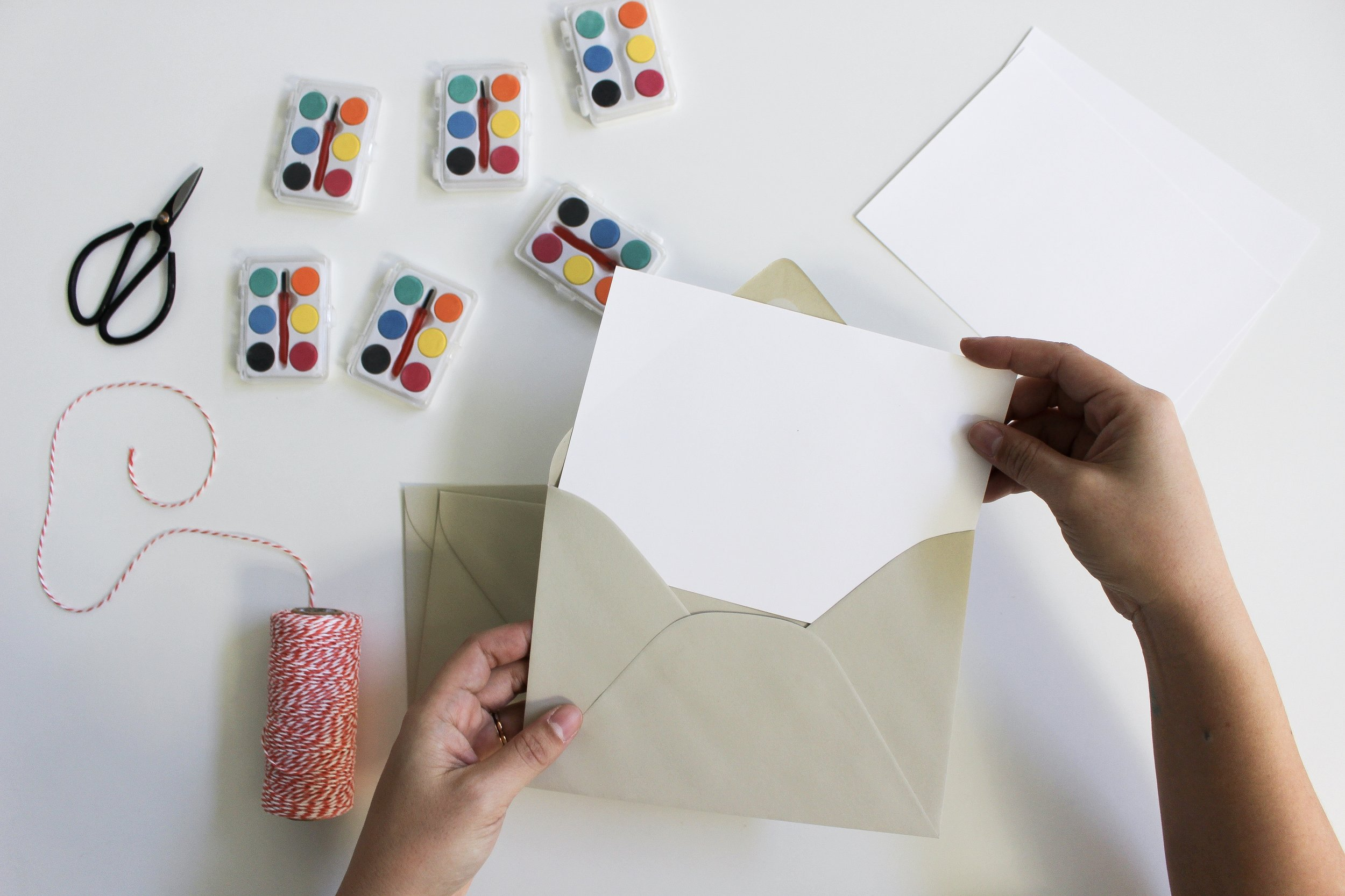 The Paper + Craft Pantry Blog: Putting our card into an envelope to gift.