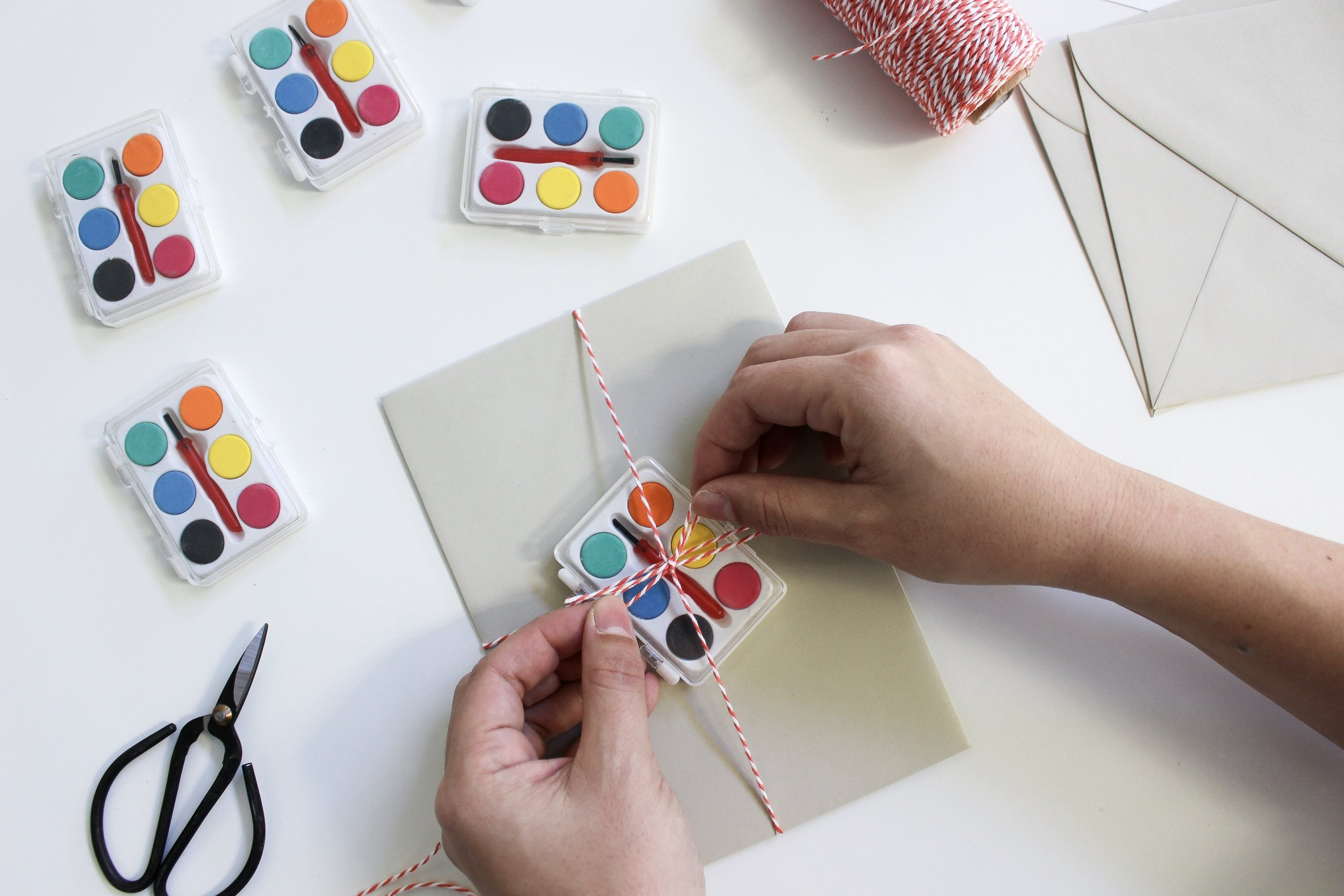The Paper + Craft Pantry Blog: Tying our mini watercolor pallets with some twine onto the envelope.