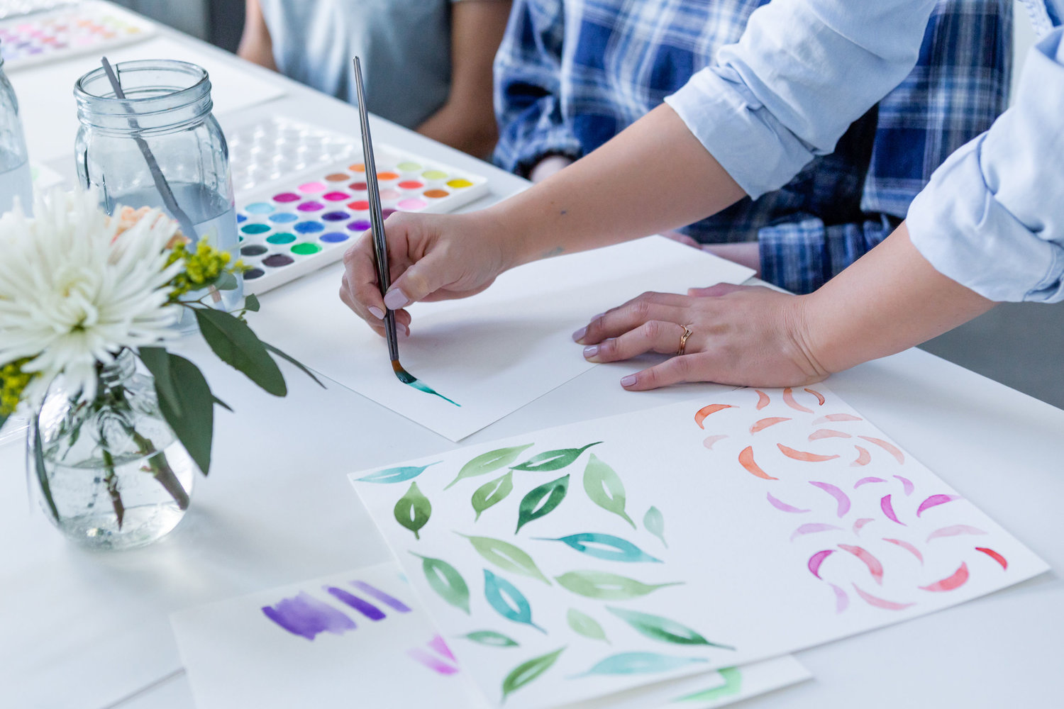 The Paper + Craft Pantry Blog: Watercolor floral workshop instructor helping to show different stroke techniques.