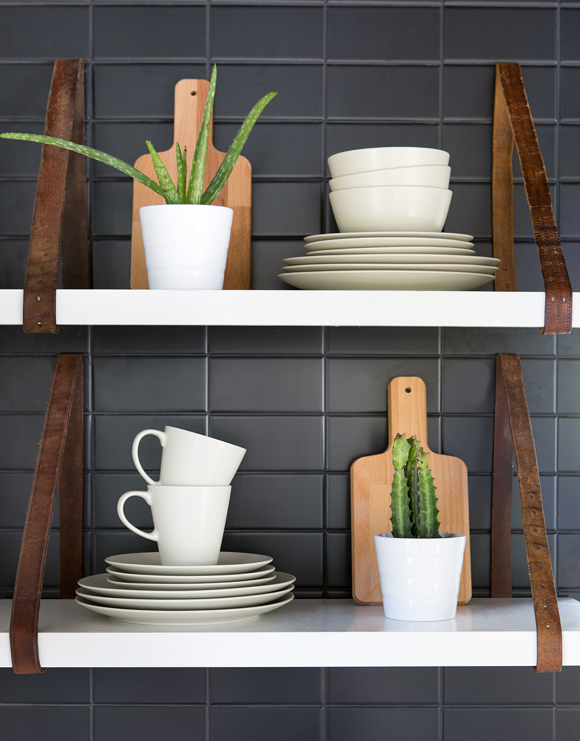 I used vintage leather belts found on South Congress Ave to hold up the shelves in the kitchen!