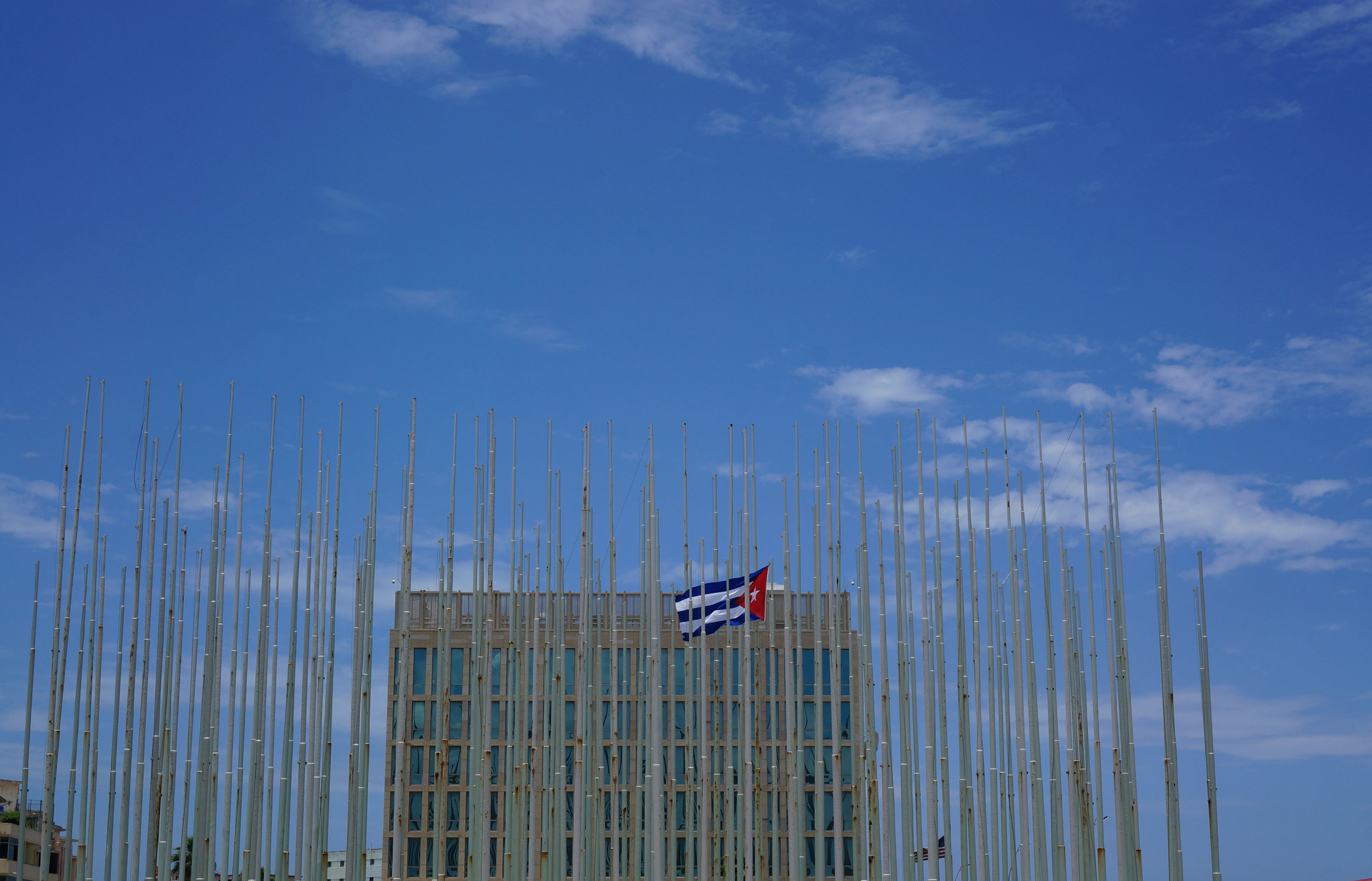 The US Embassy with the Wall of Flags standing in its foreground.