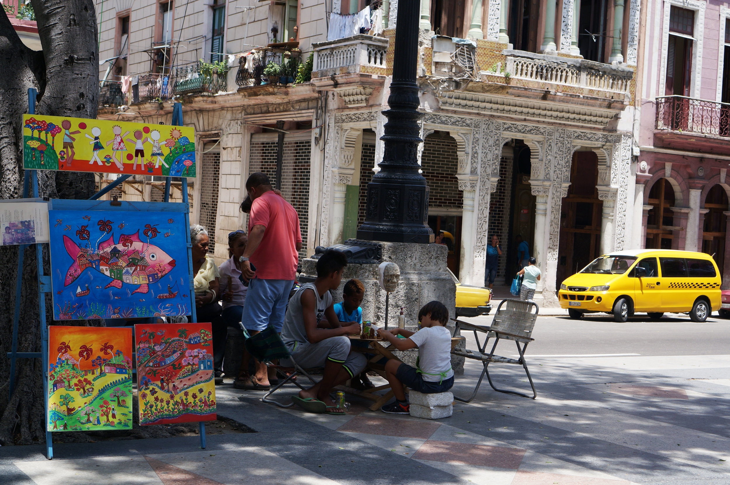 Art being made and sold on a Saturday morning on the Prado.