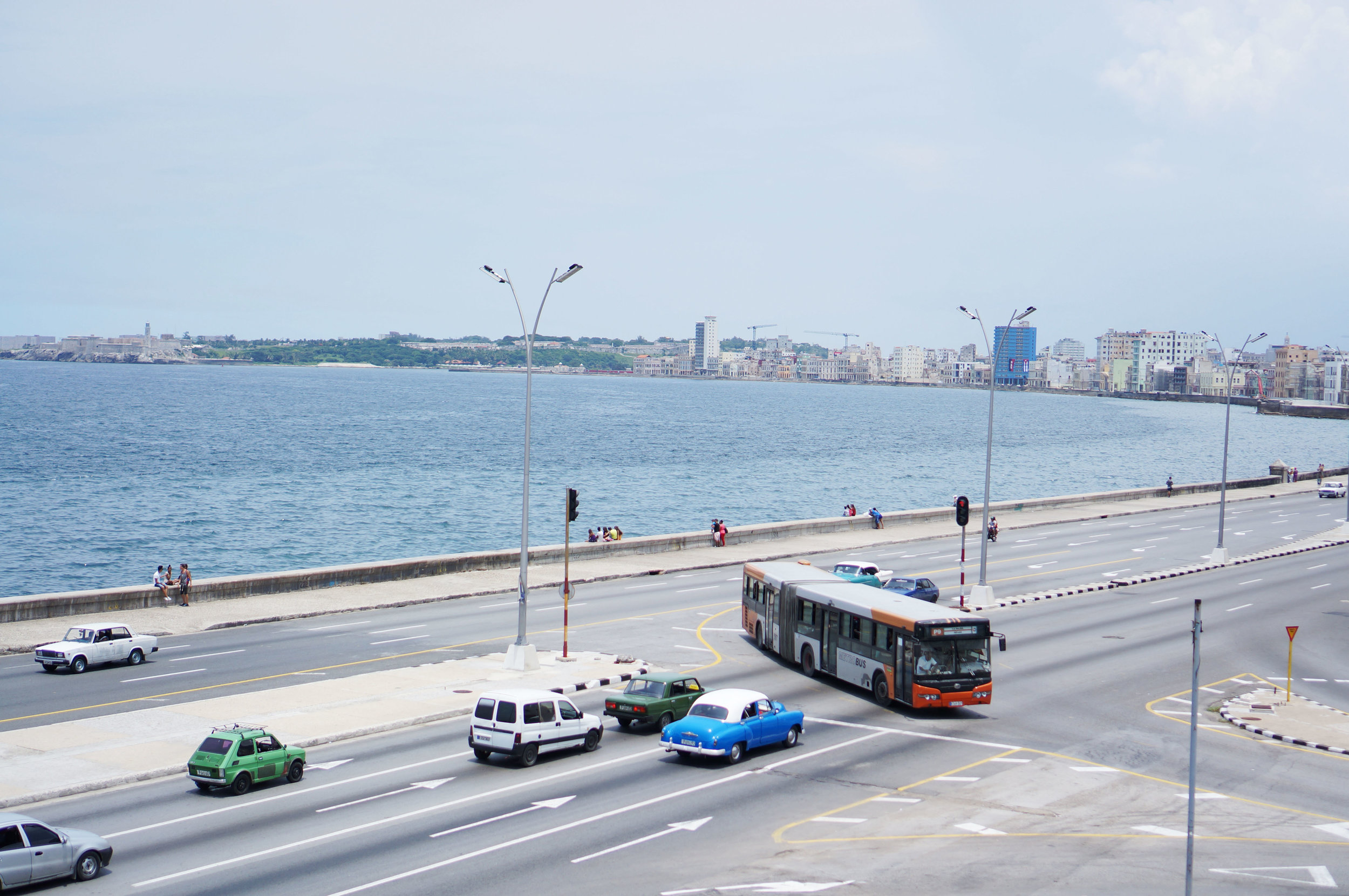 One of my favorite places to sit was at the base of the flagpole watching all the cars drive along the Malecón.