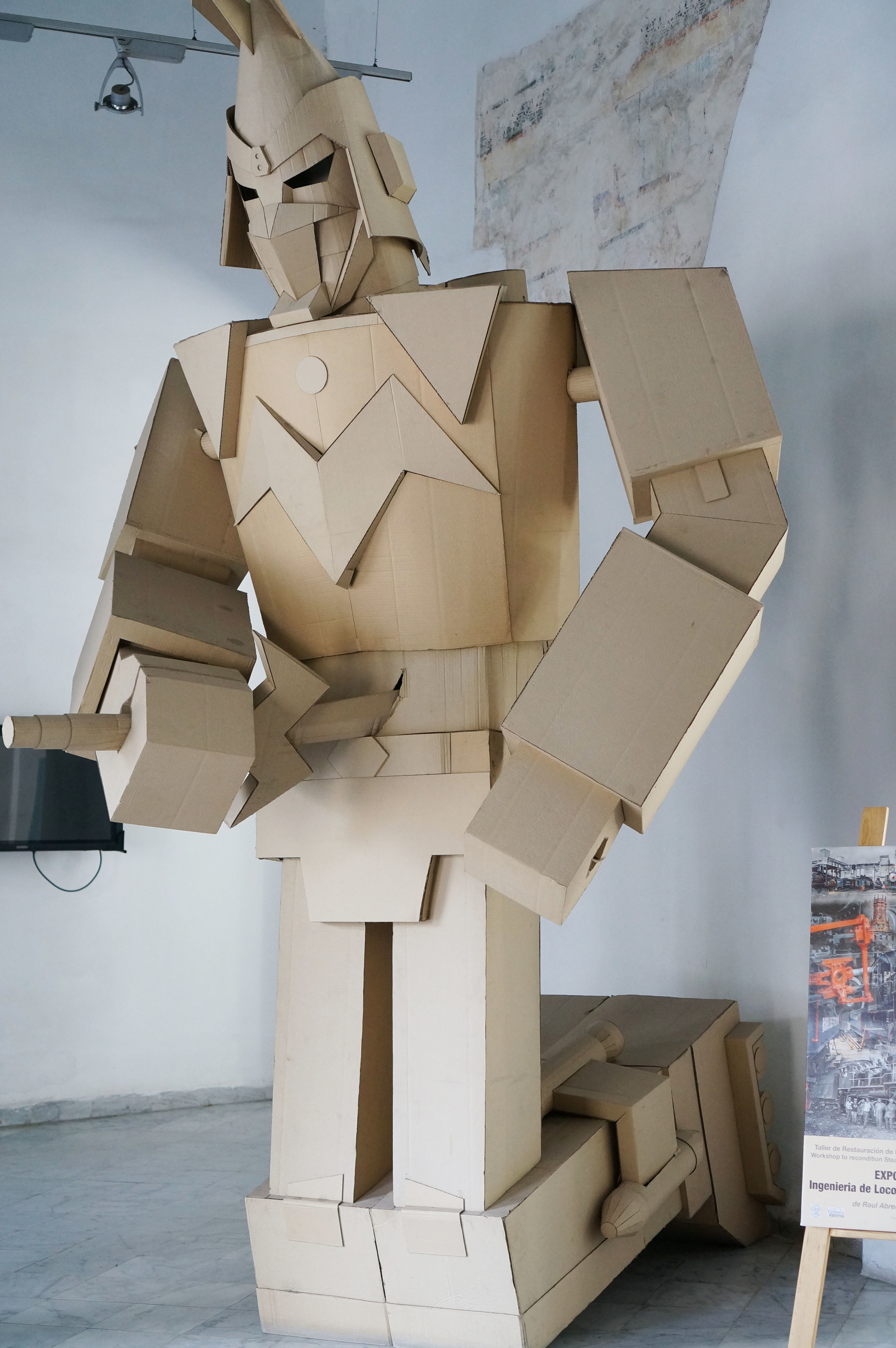 Cardboard robot on display at a small gallery
