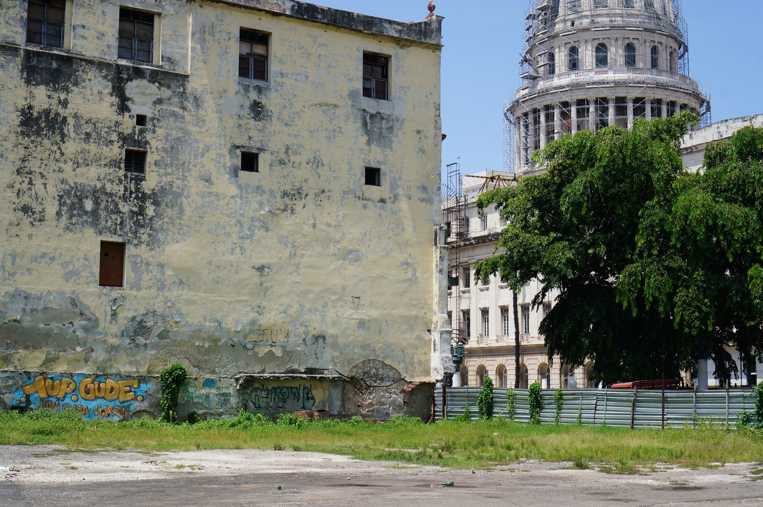 Near the entrance to Havana's Chinatown, contrasts of decay and restoration.