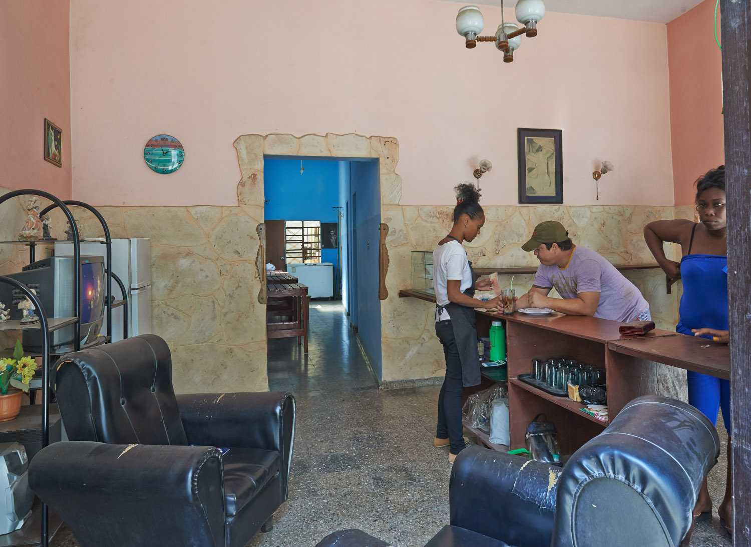 HAVANA. A LIVING-ROOM AS A TAKE-AWAY RESTAURANT. A WAY FOR A LOT OF CUBANS CUBANS TO EARN A LIVING
