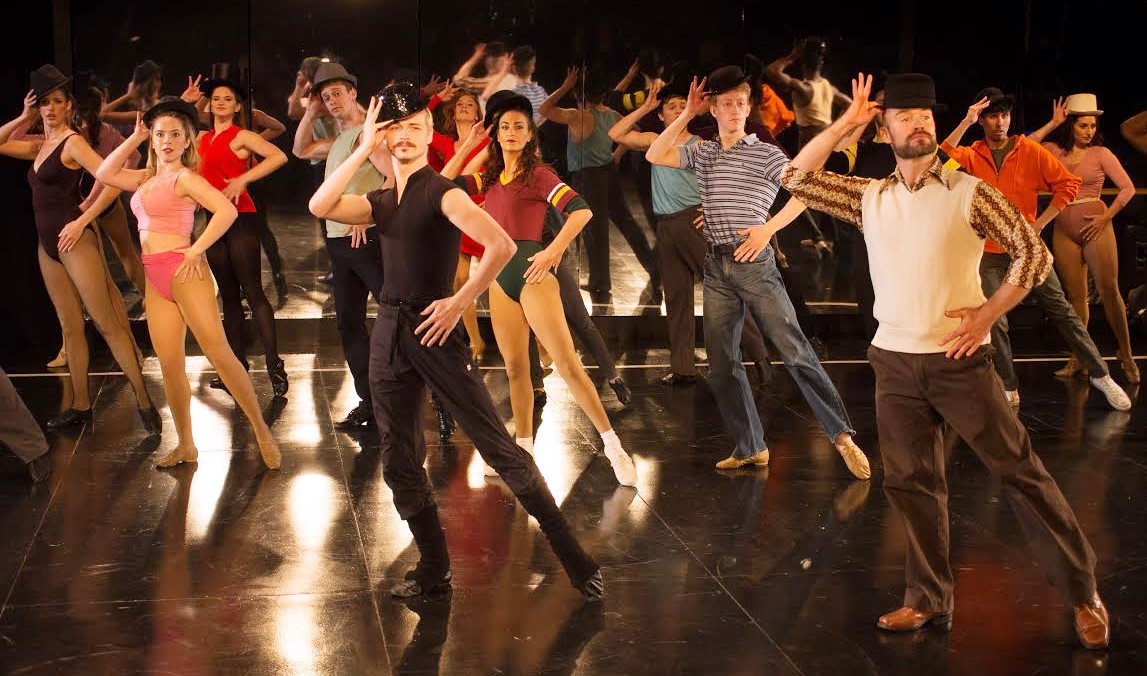 Zach (Eric S. Robertson, in white vest) with assistant Larry (Spencer Pond), and the cast of A Chorus Line (photo: Rich Wagner)