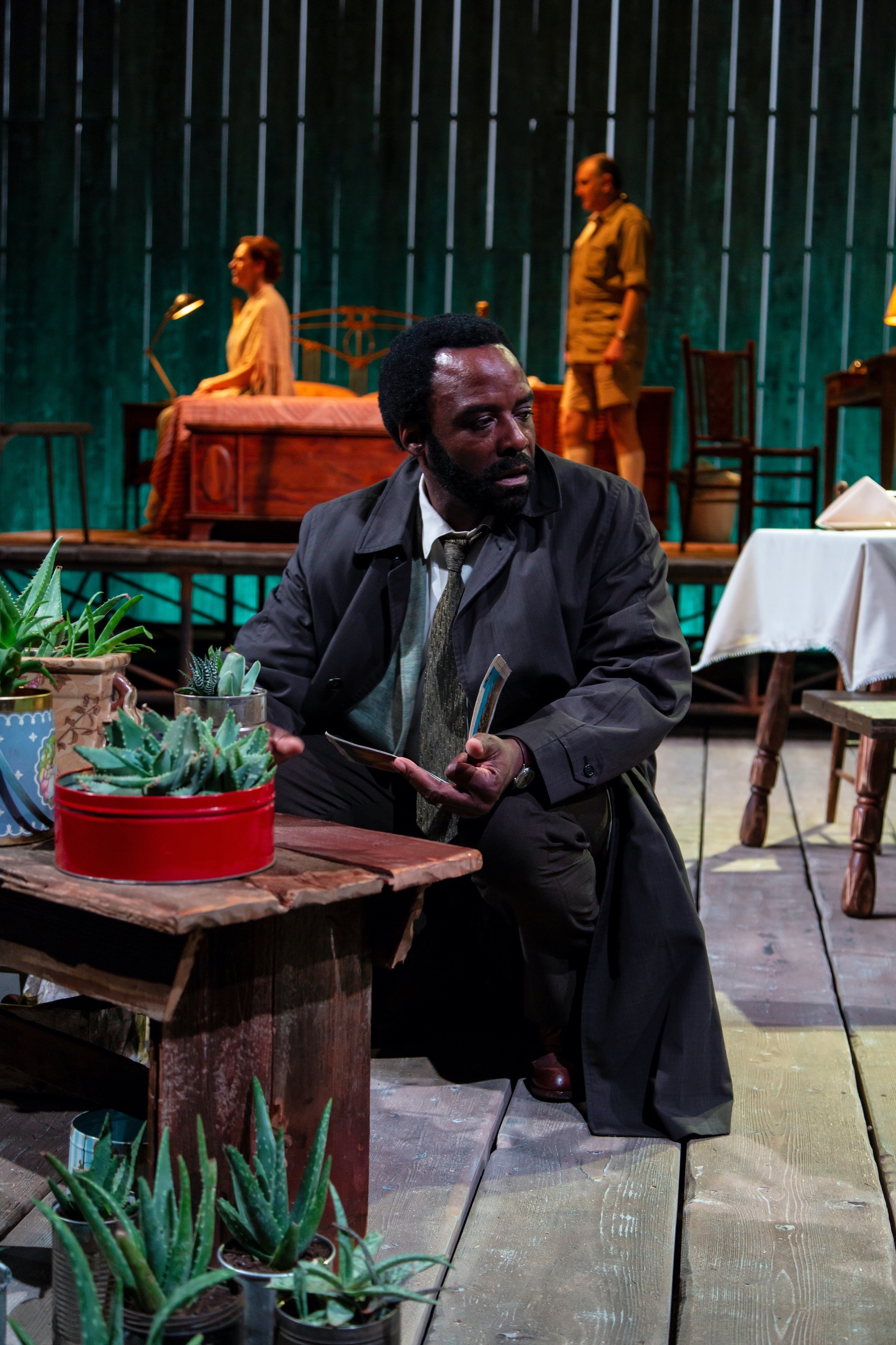 Steve (Ariyon Bakare), foreground; Gladys (Andrus Nichols), Piet (Randall Newsome), background (photo by T. Charles Erickson)