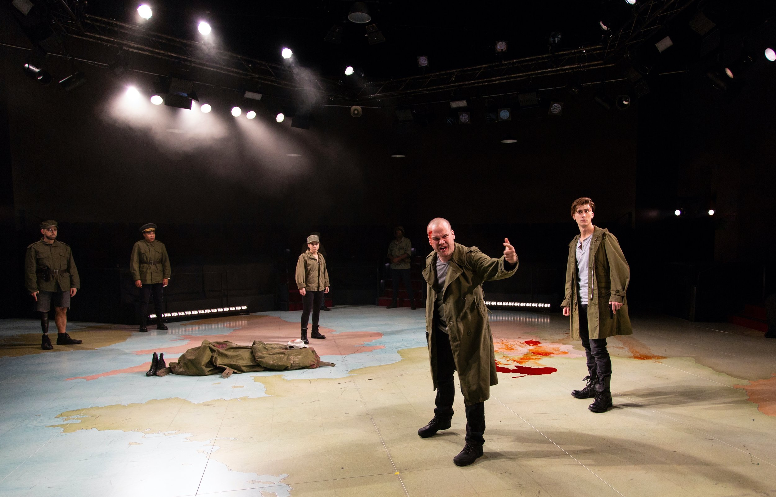 Henry (Stephen Louis Grush), foreground, and the cast of Henry V at Hartford Stage (photos by T. Charles Erickson)