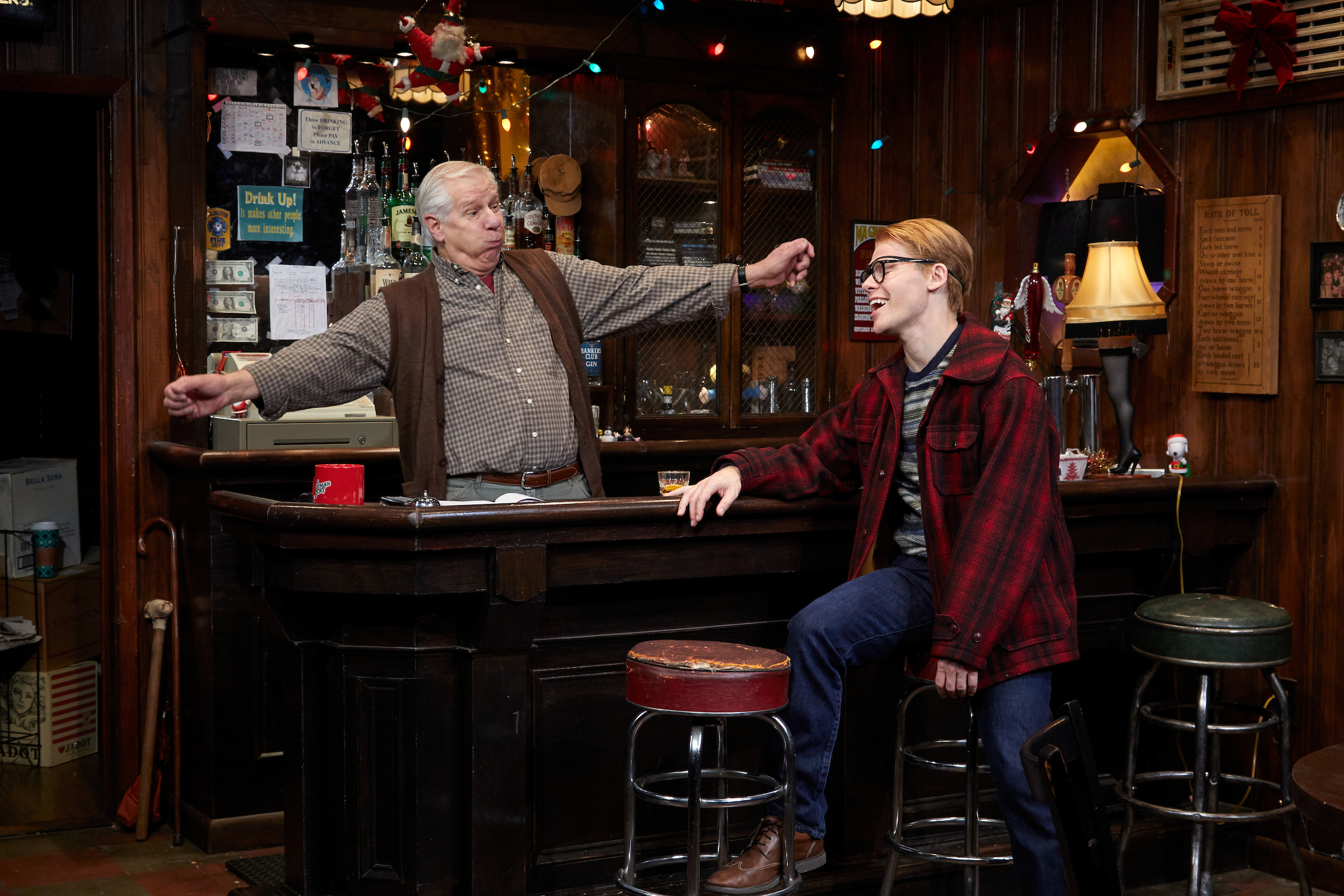 The Bartender (Tom Bloom), Ralph (Randy Harrrison) in TheaterWorks' Christmas on the Rocks