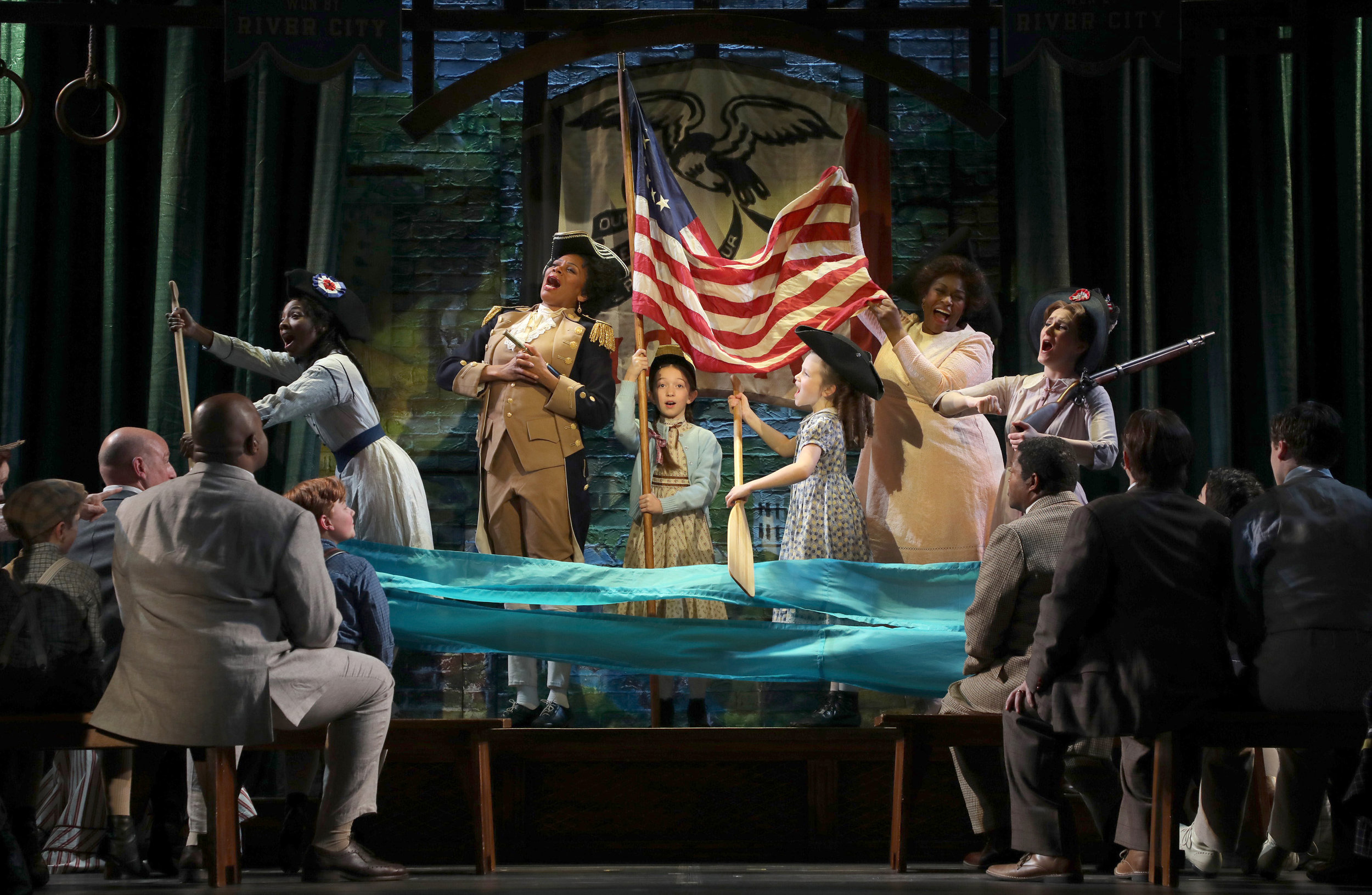 Eulalie Mackecknie Shinn (Stephanie Pope, standing second from left) and the cast of The Music Man